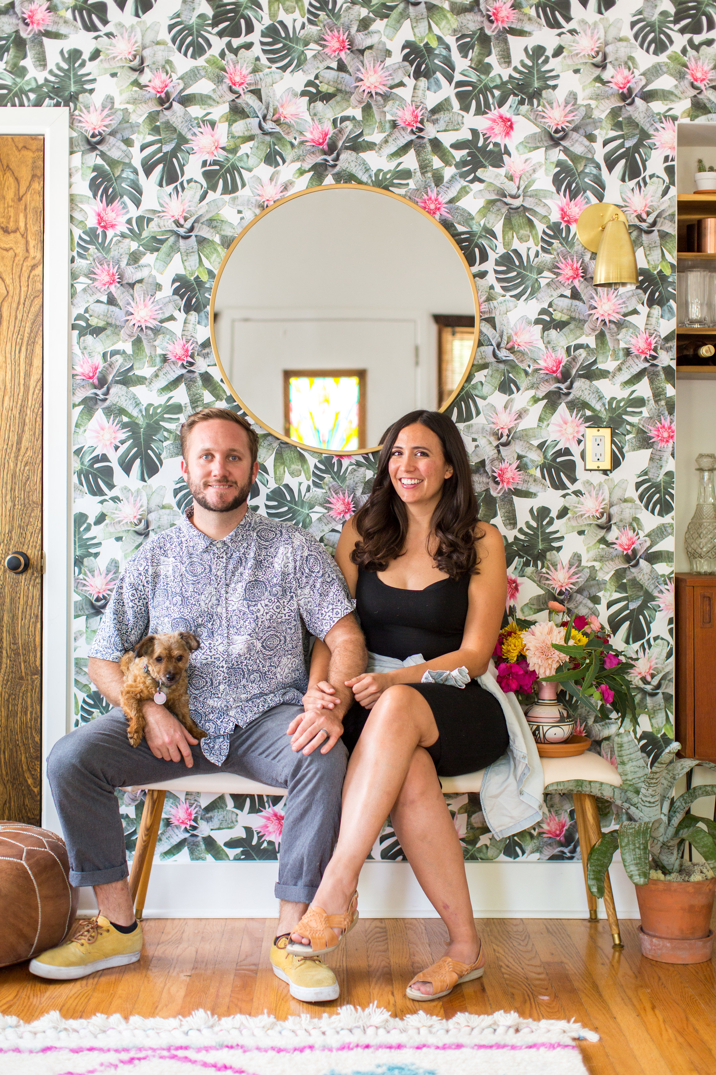 Samantha Santana & her husband James Lively in her home (in 2017), featuring her rad bromeliad wallpaper. Oh, and their puppy Animal is there too. Photo Credit - Marissa Vitale