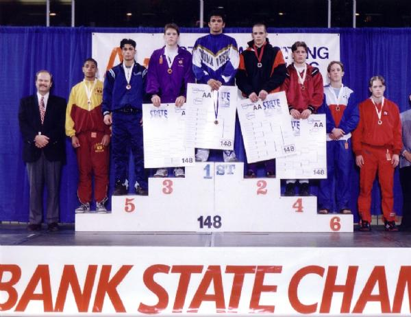 Dennis Maxon keeps his promises. After being eliminated from the state tournament on the first day without placing his junior year, he made a promise to coach Higa that he would come back the next year focused and serious enough to win state. That determination paid off a year later when Dennis found himself standing atop the state podium triumphant and champion of the 148 lb. weight class. His toughness and heart also inspired the team to push harder; that year the Bears also won a team title with Dennis as Captain.