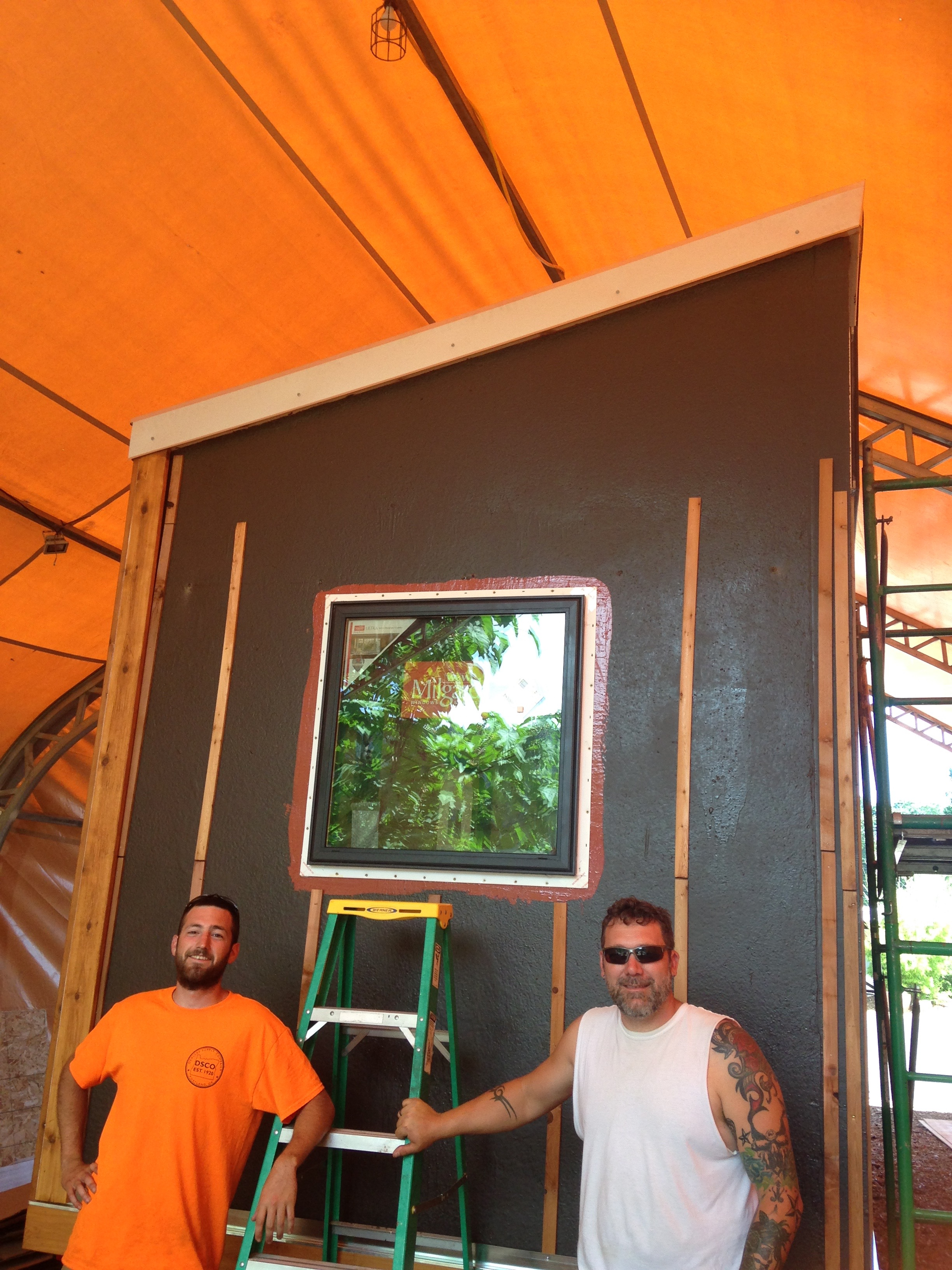 Tom and Jeremy showing off the start of our metal roof