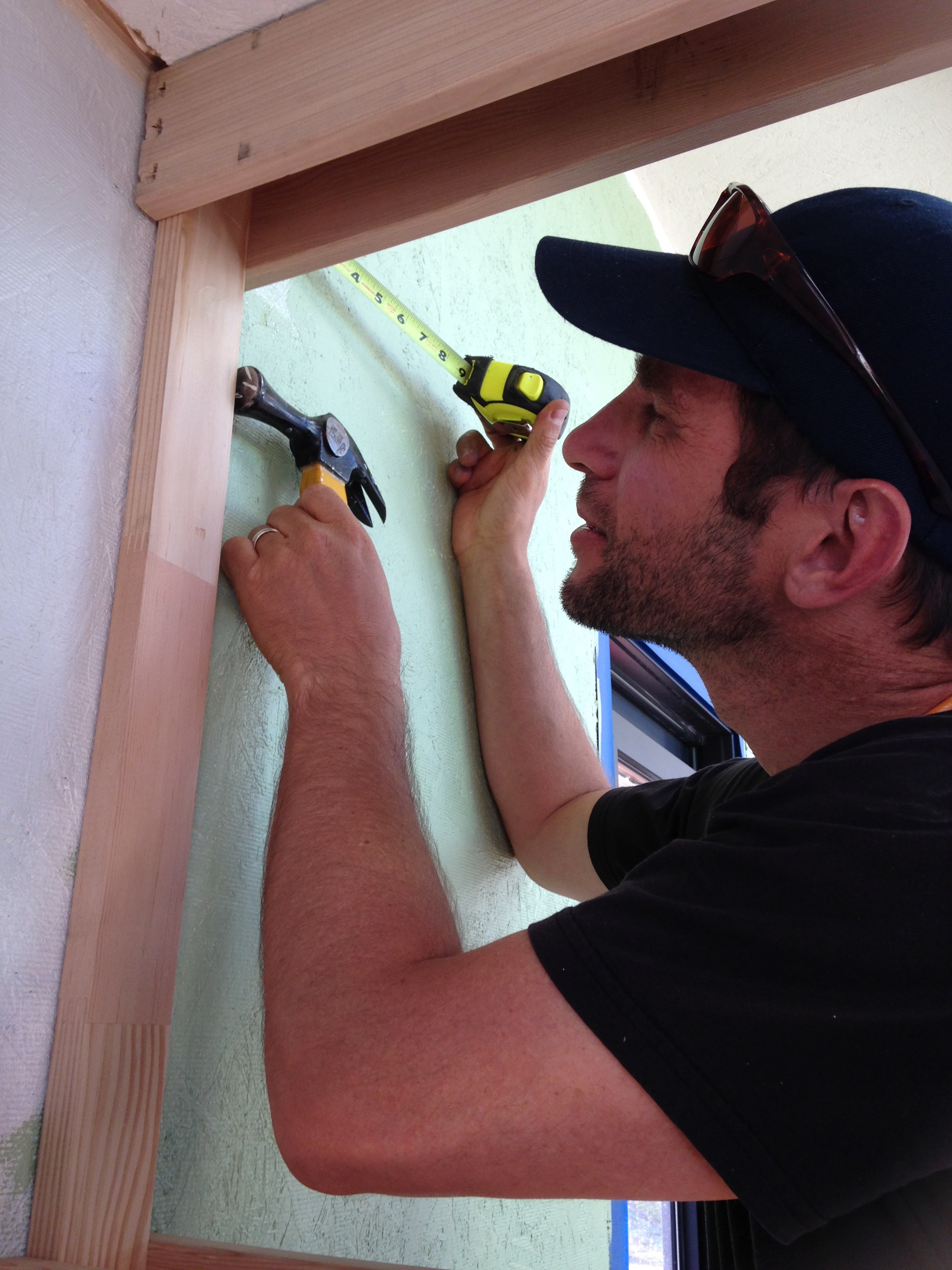 Isha installing the pocket door (doesn't that ring look great on him!?)
