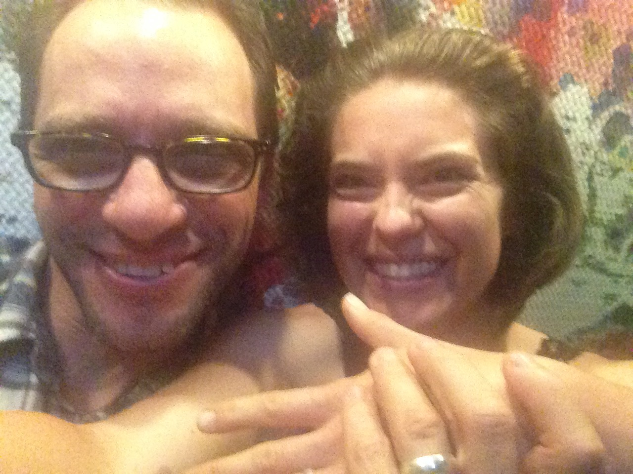 Learning how to take selfies to show off our engagement rings!