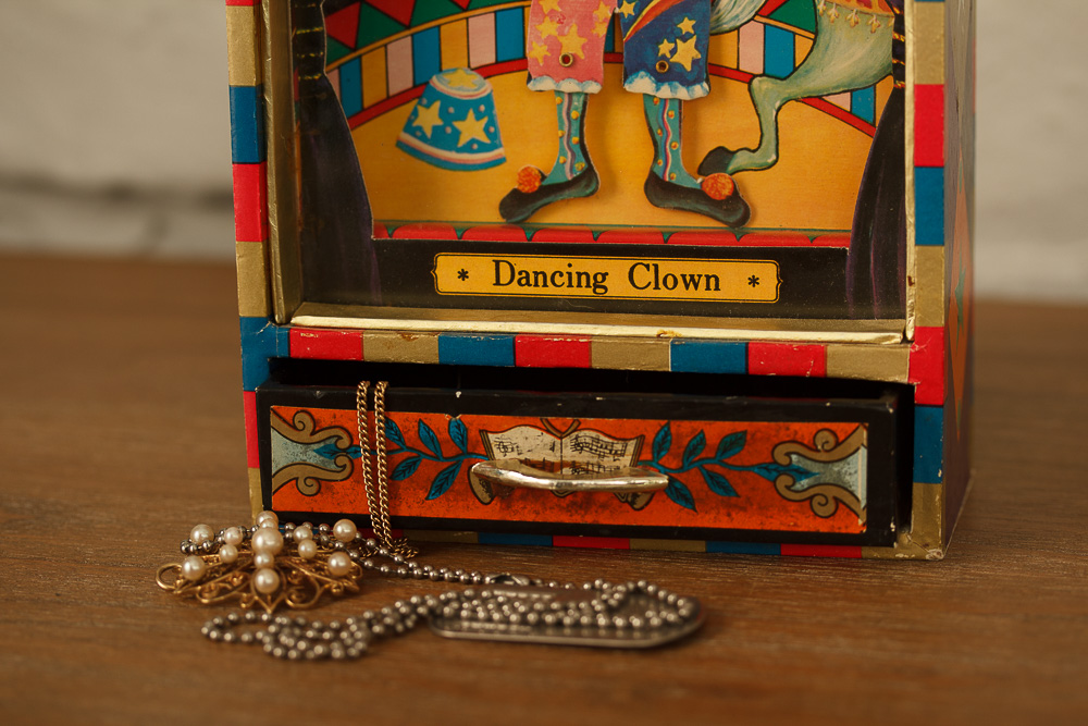"""My childhood treasure. A music box my father gave me when I was five or six years old. Turn a little crank in back,open the drawer at the bottom, and the song """"Send in the Clowns"""" plays."""