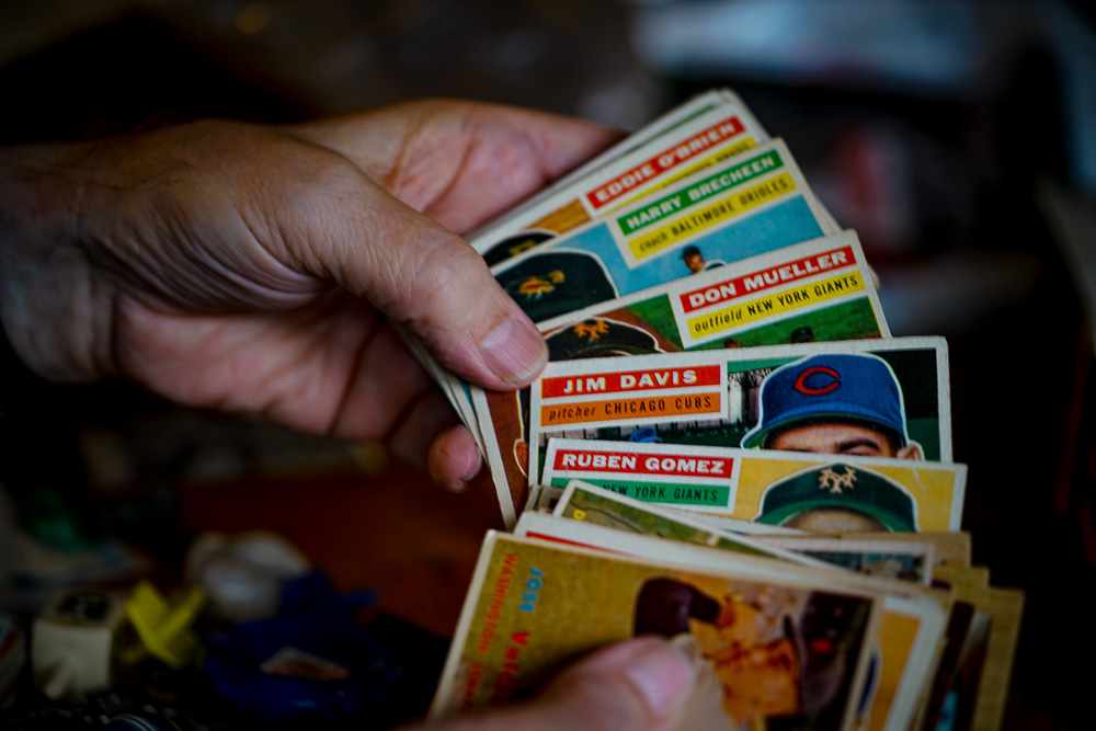 My dad holding his baseball cards.
