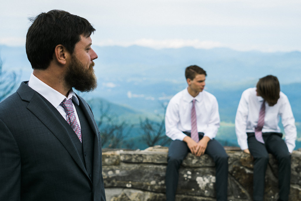 groom admires sons