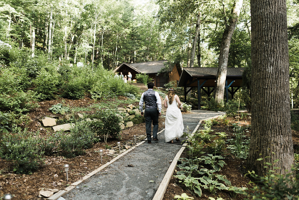 bride and groom arrive to reception at Nantahala Weddings