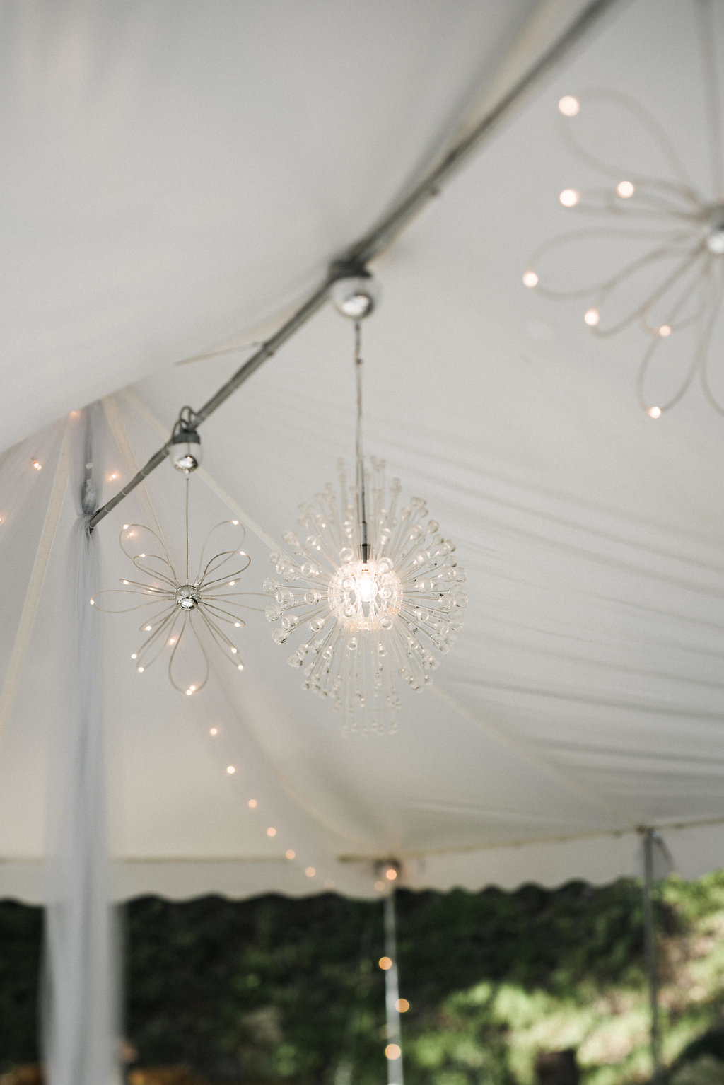 under tent lights at Nantahala Weddings