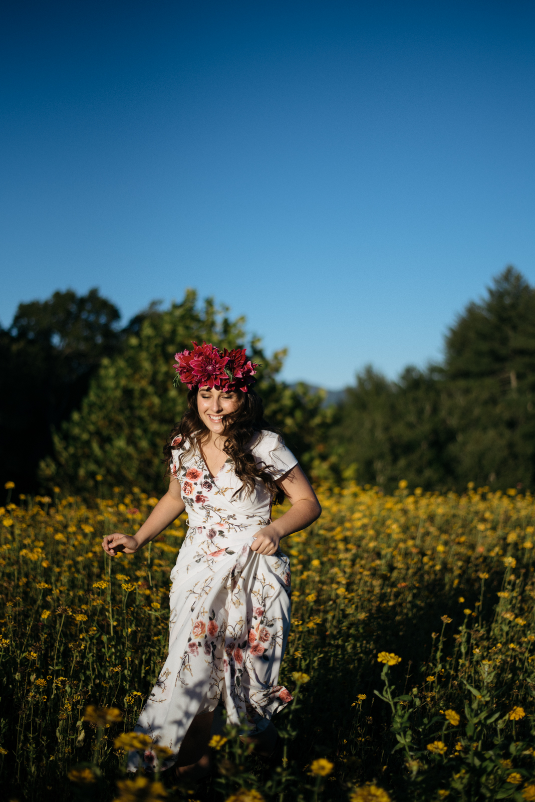 flower crown on girl running in field