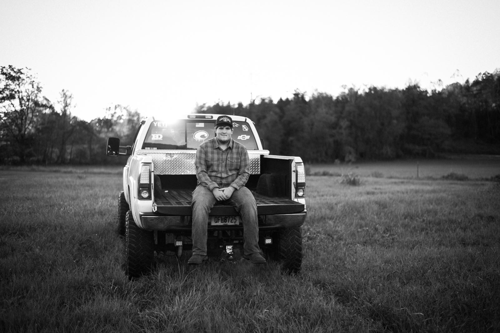 Senior on back of truck