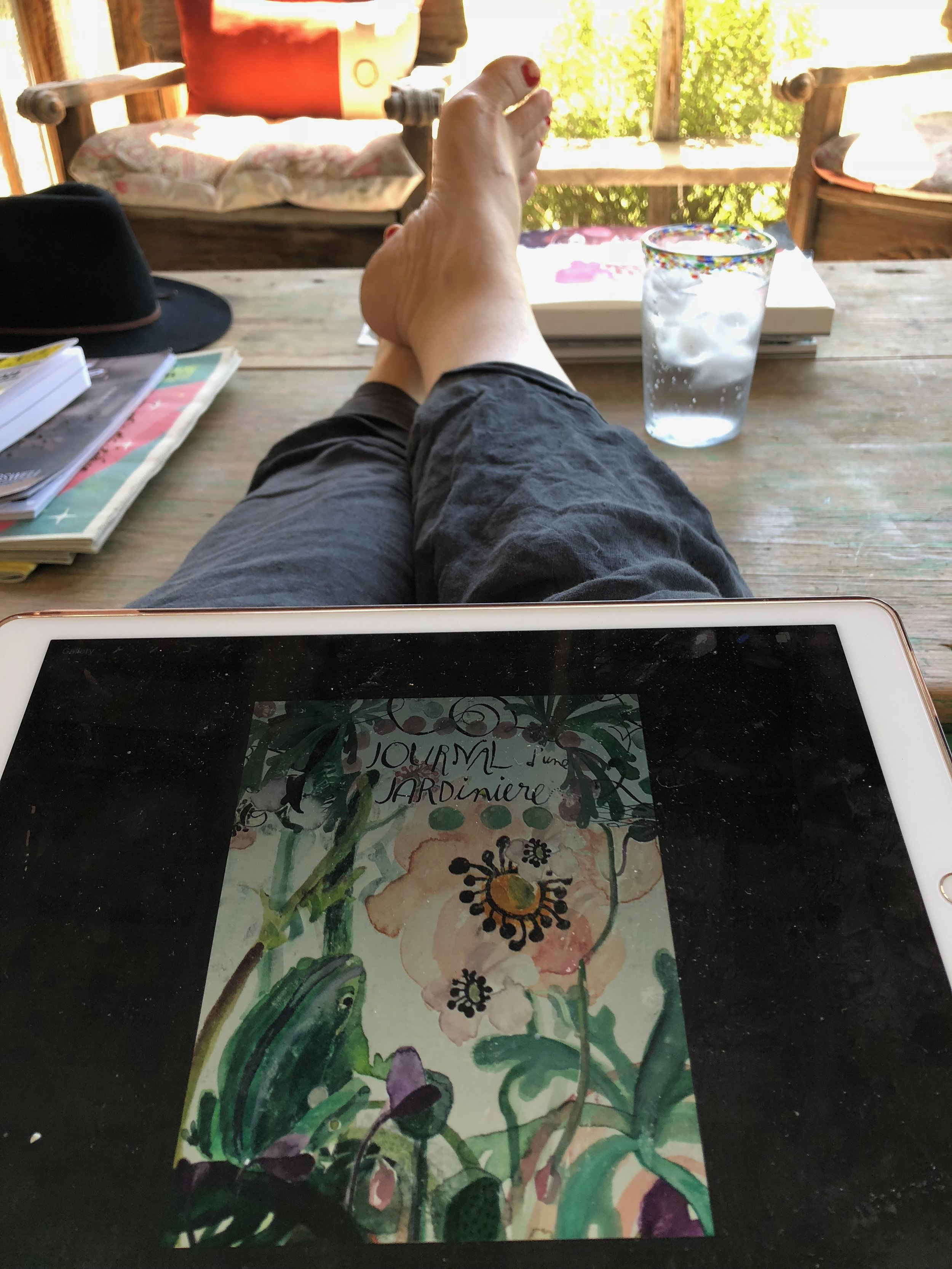THE LIFE. Don't mind my chipped nail polish and adorable chubby Hobbit toes--concentrate on how illustrators get to do it!