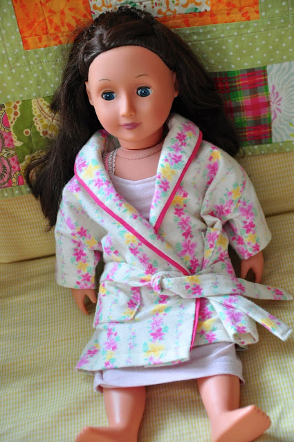 Victoria in her nightgown and robe.