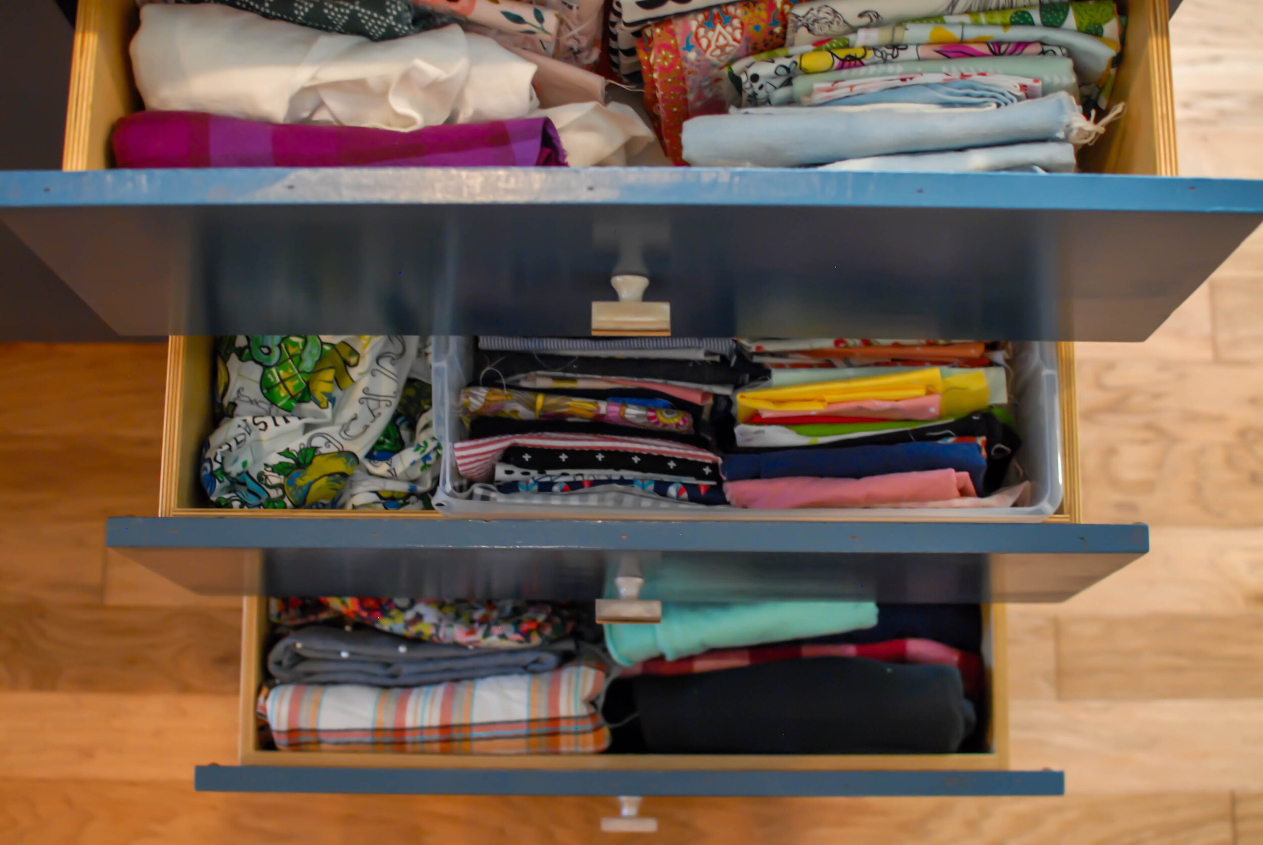 Here's how I organize my sewing room using the best tip from organization guru, Kon Marie Kondo! Come see my best tips for how to keep your sewing room neat and organized. || Pin Cut Sew Studio #sewingroom #konmarie #craftroom #organization