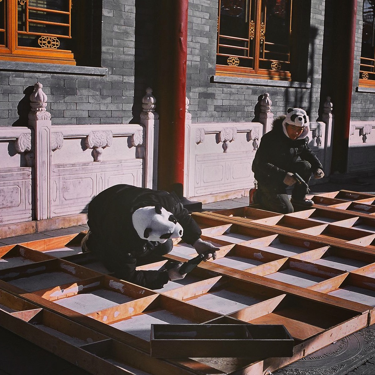 Migrant workers wear panda hats on a freezing cold day in Beijing.