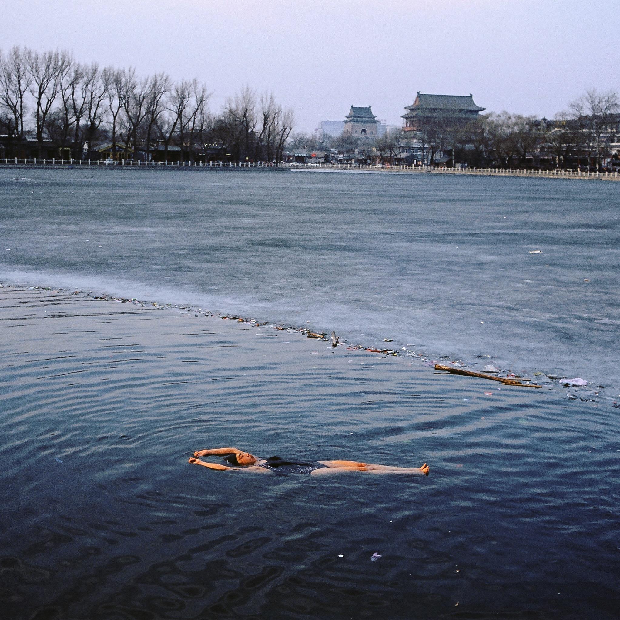 A winter swimmer relaxes in frozen Houhai Lake, Beijing.