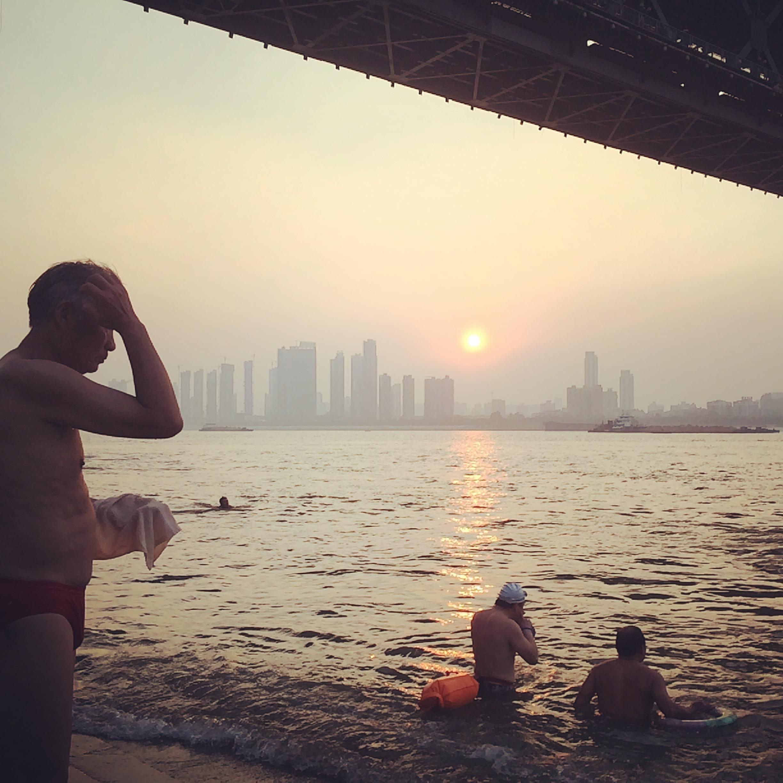 Old men take a swim in the Yangtze River, Wuhan.