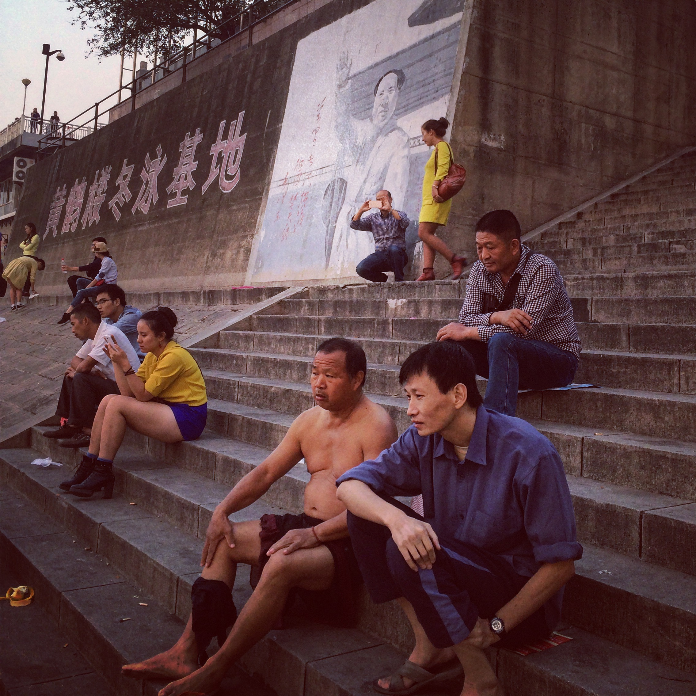 Locals relaxing by the Yangtze River where Chairman Mao famously took a swim to prove his stamina as national leader. Hubei Province.