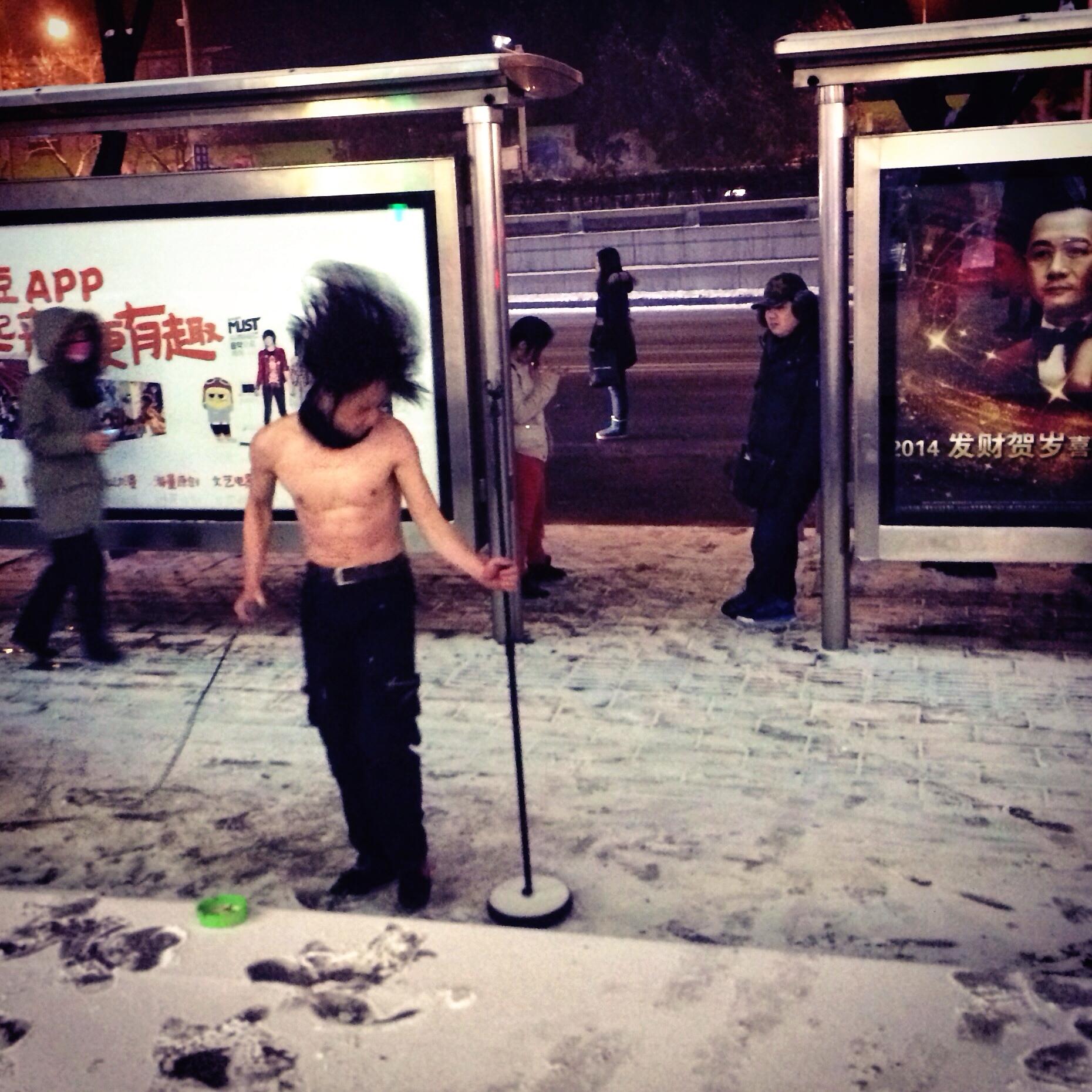 A heavy metal busker performs on a Beijing street in winter.