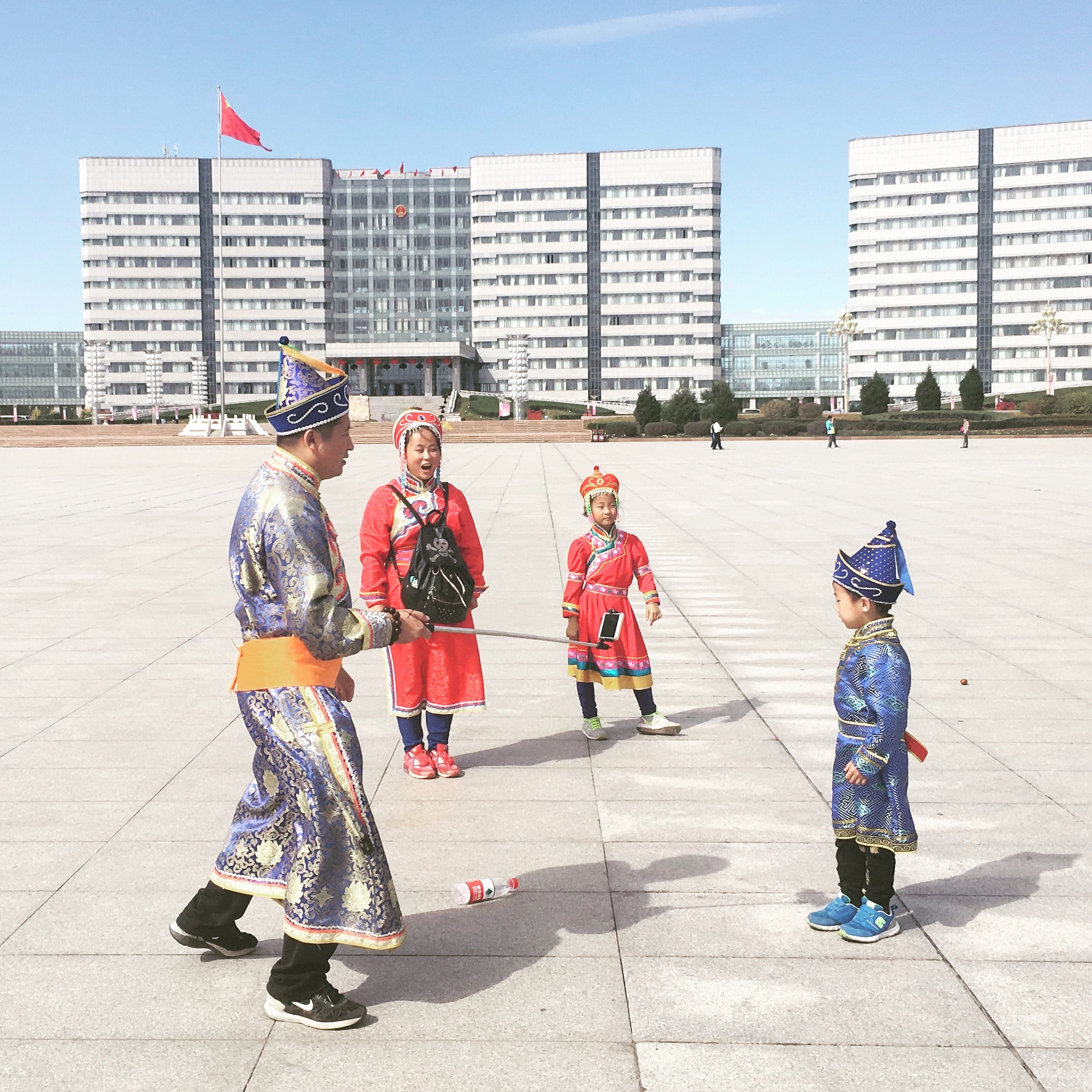 "Chinese tourists dressed in Mongolian outfits in the deserted ""ghost city"" of Ordos."