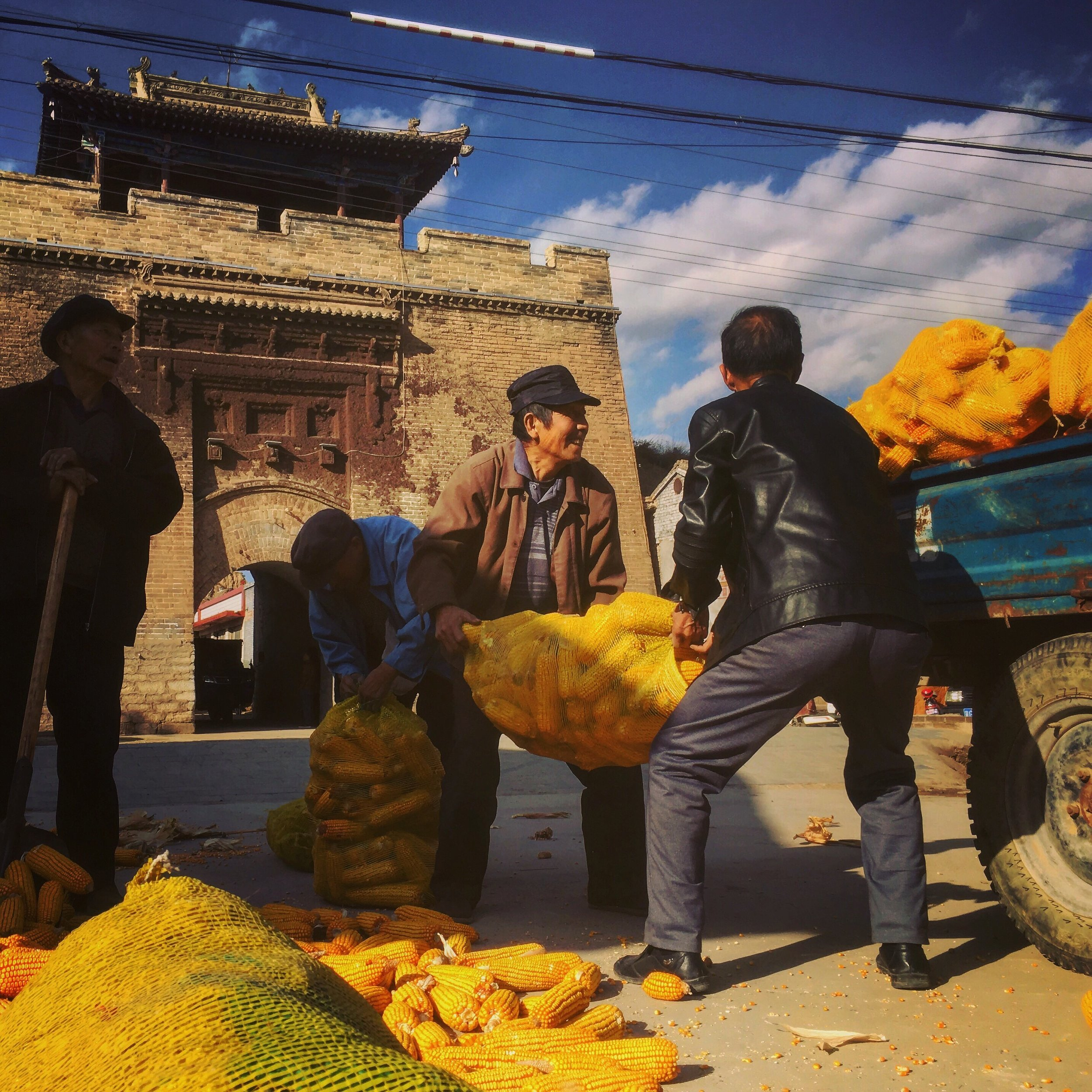 Farmers wrap up the corn harvest in a village in Shanxi Province.