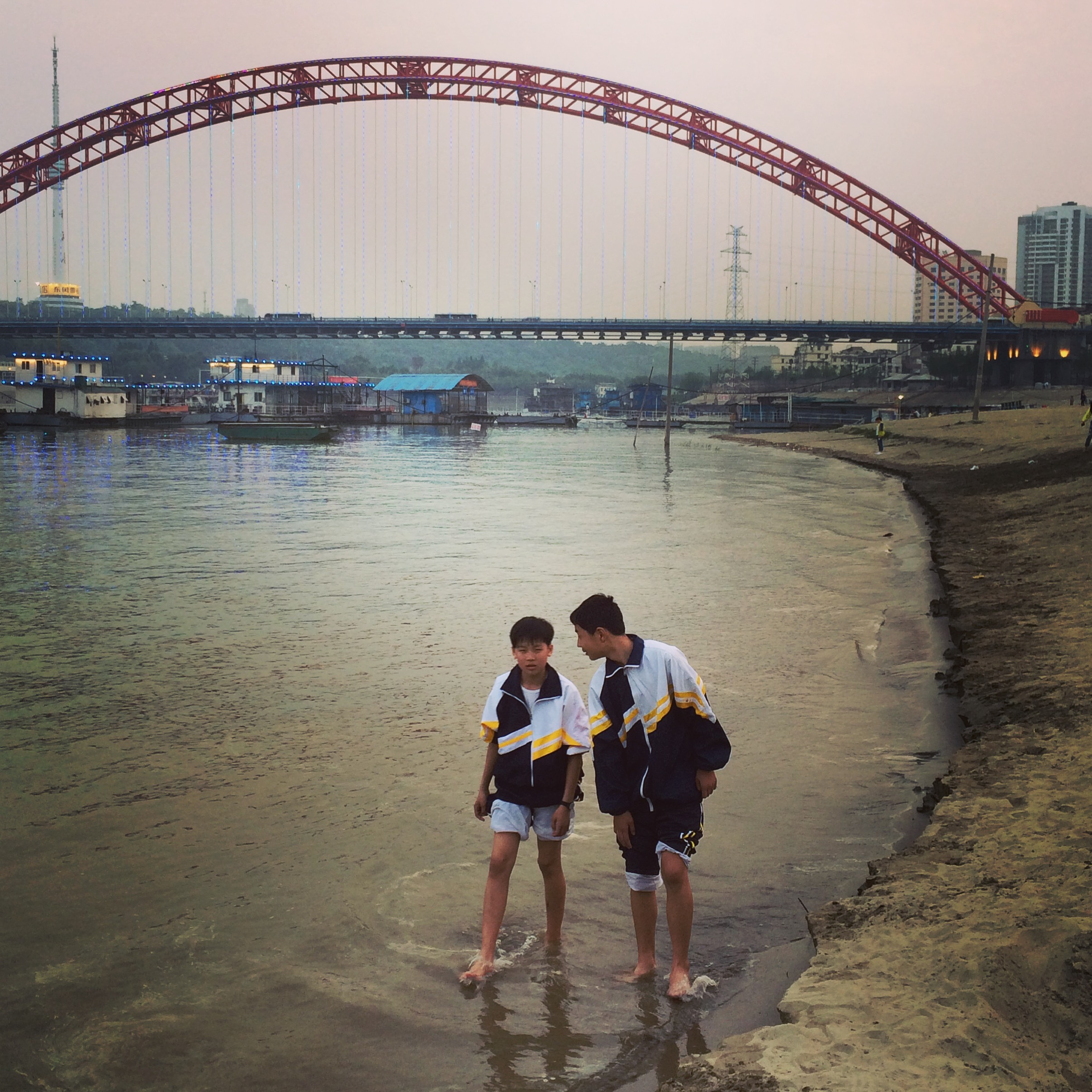 High school kids wading paddling in the Yangtze River, Wuhan.