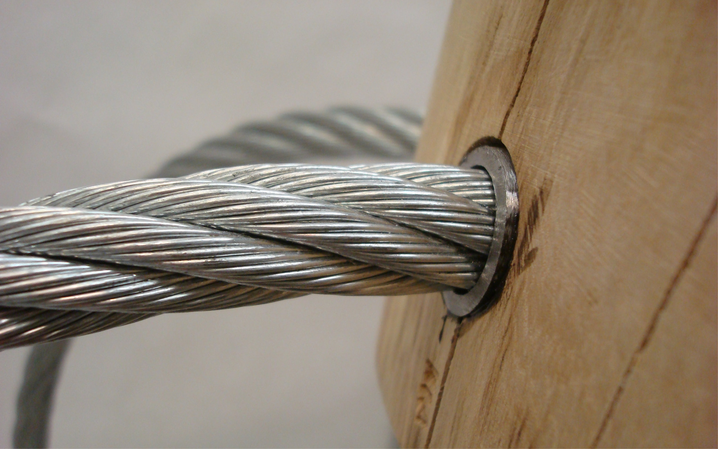 I selected minimal, press-fit hardware that would hold the members in place securely but unobtrusively, and left the elm -- sourced from the forests around my family home in New Hampshire -- in its raw form to preserve its natural beauty and contrast the industrial aesthetic of the braided steel cable.