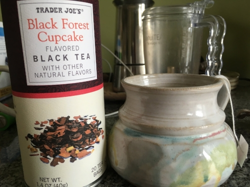 Currently drinking: Black forest cupcake tea in a fairy colored mug. Reminds me of Sophia's hair from  Awaken , referenced below.