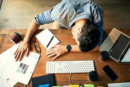 iStock-sleeping-lazy-idle-office-tired-exhausted-overworked-625737620.jpg