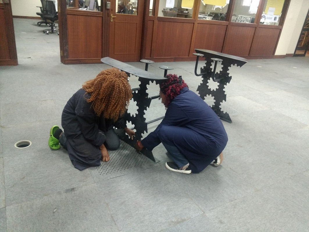 Esther and Anastacia (Product Designer) Assembling the table.