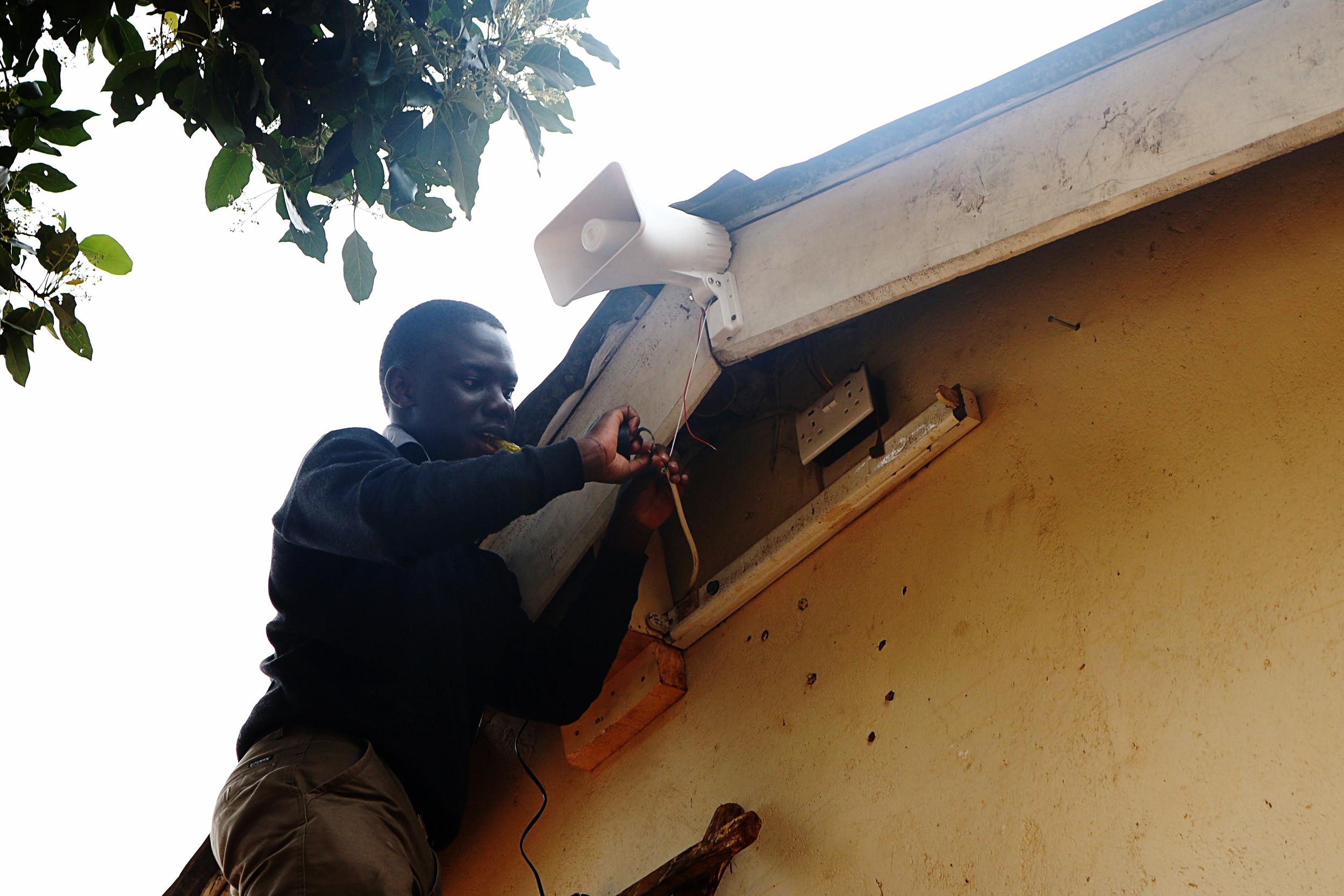Oki installing the bell