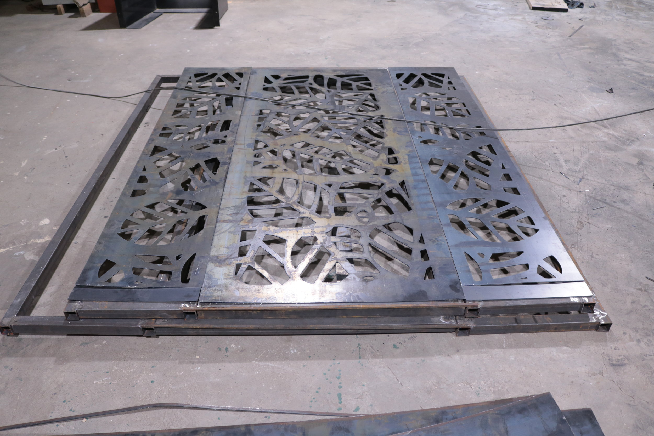 Making of the gate. The client had a specific design that he needed for his gate with a metal material. After the computer design, the CNC plasma cutter cut the design on the sheets of metal and thereafter the client left with the pieces to assemble them at home.