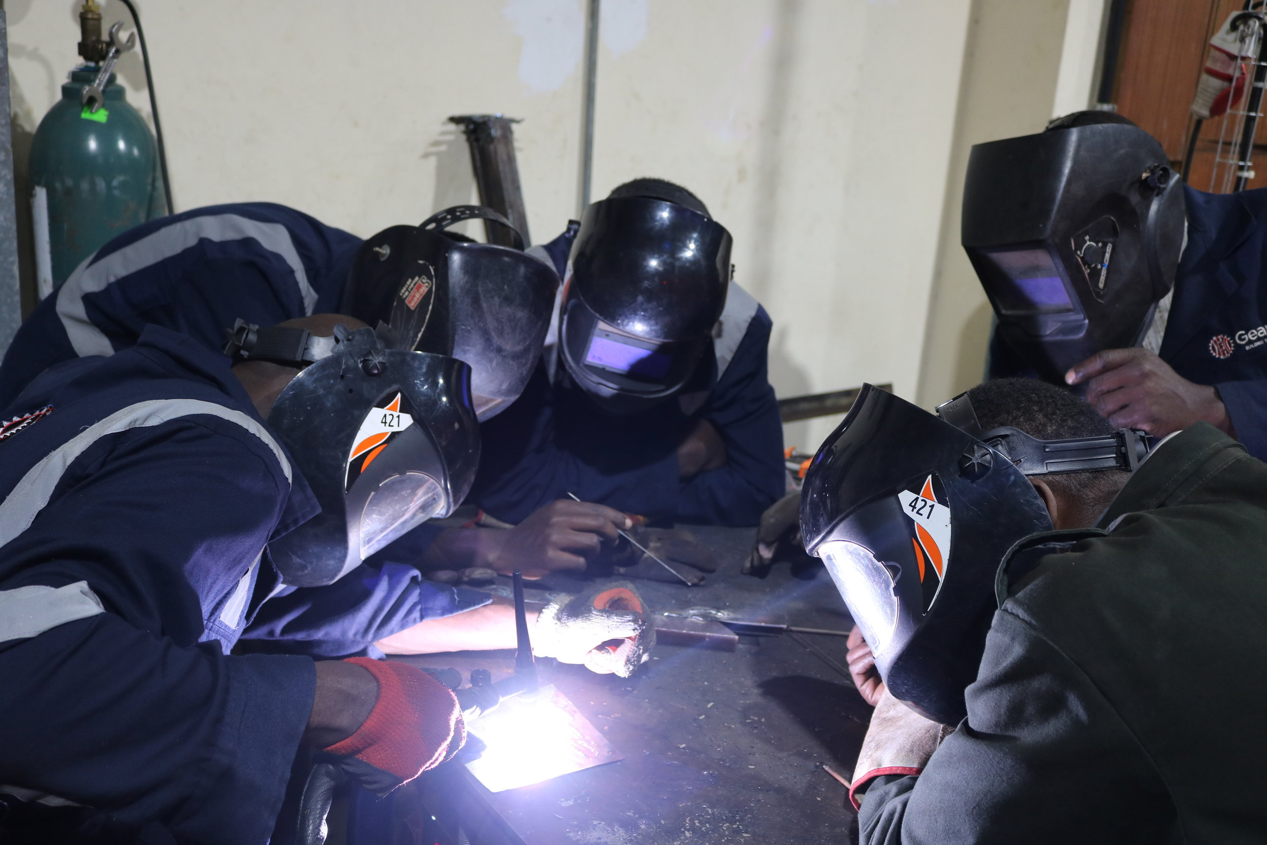 Juakali trainees being taught how to weld