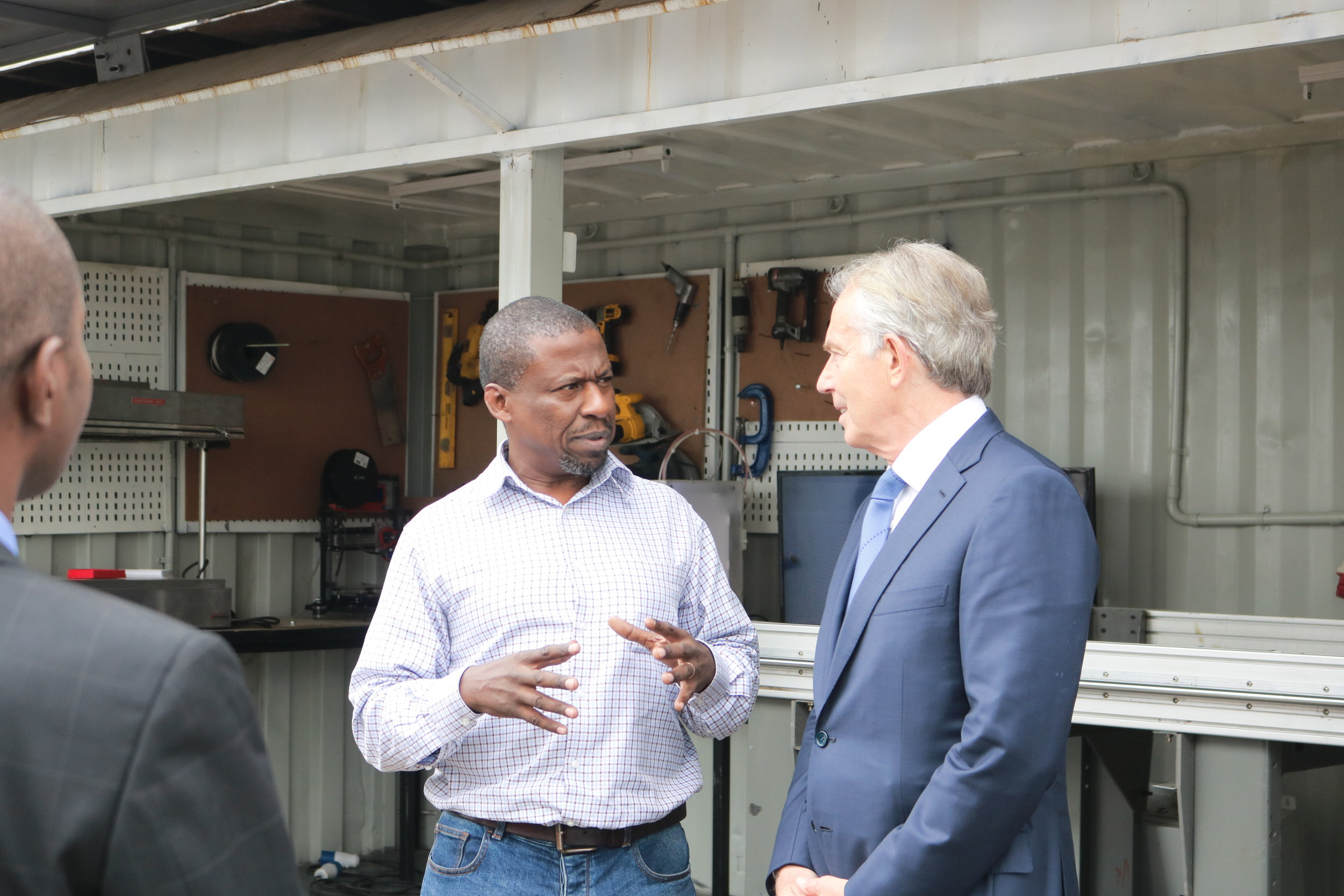 Dr. Kamau Gachigi with Tony Blair outside Gearbox