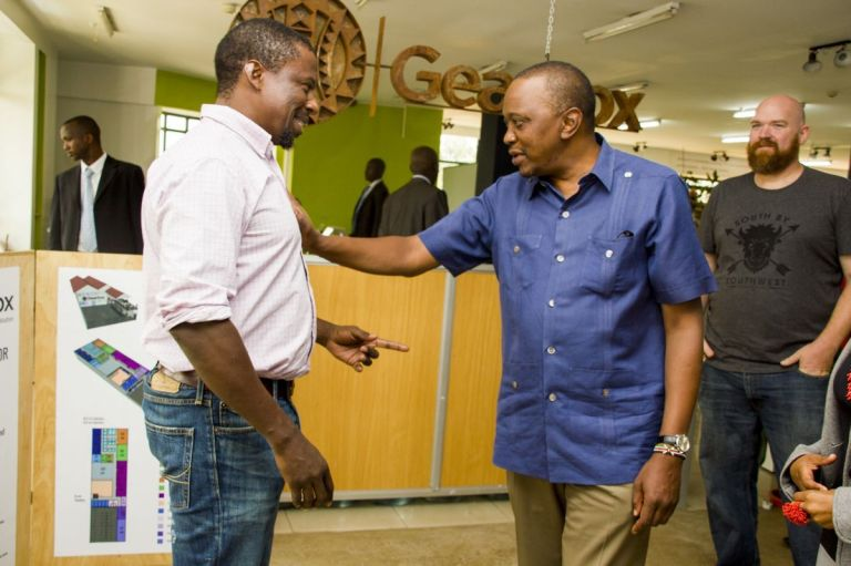 (Kamau Gachigi – left – engages in chat with President Uhuru Kenyatta during a visit to the facility. On the right is Erik Hersman, the co-founder of iHub and BRCK. Photo:      iHub     ).