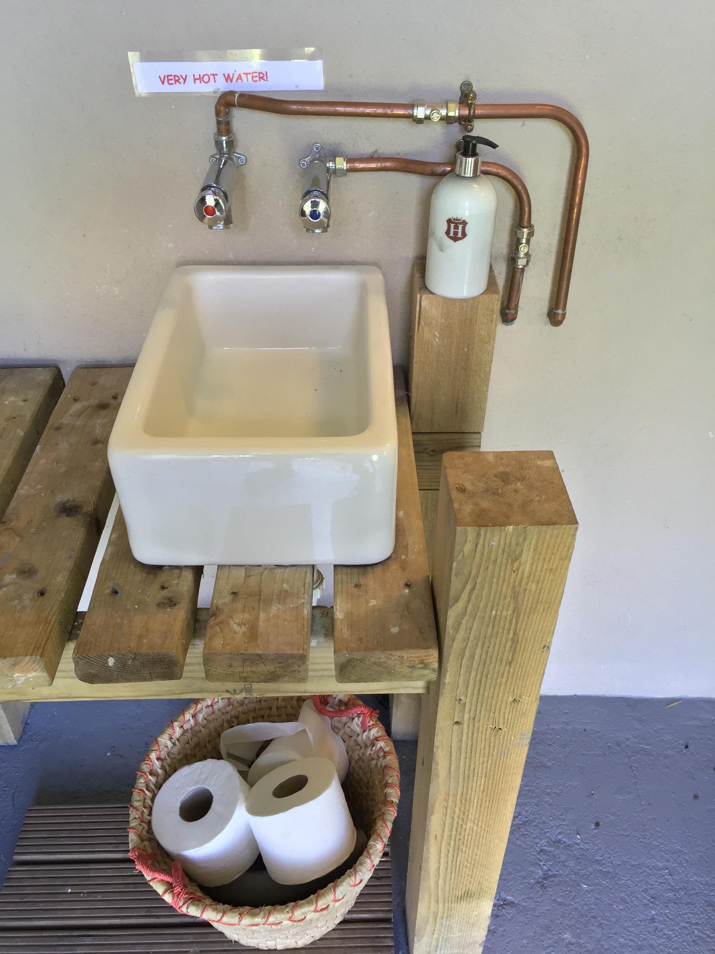 Camp Hartland Belstaff sinks and hot water