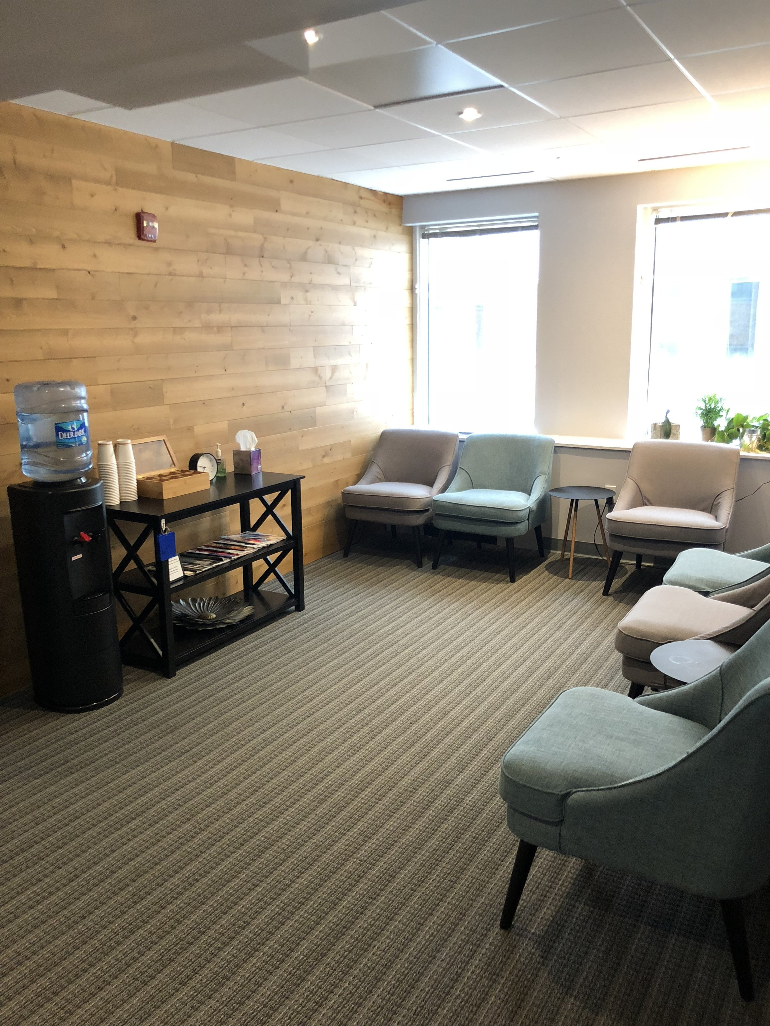 The suite's spacious waiting area offers water and an assortment of teas.