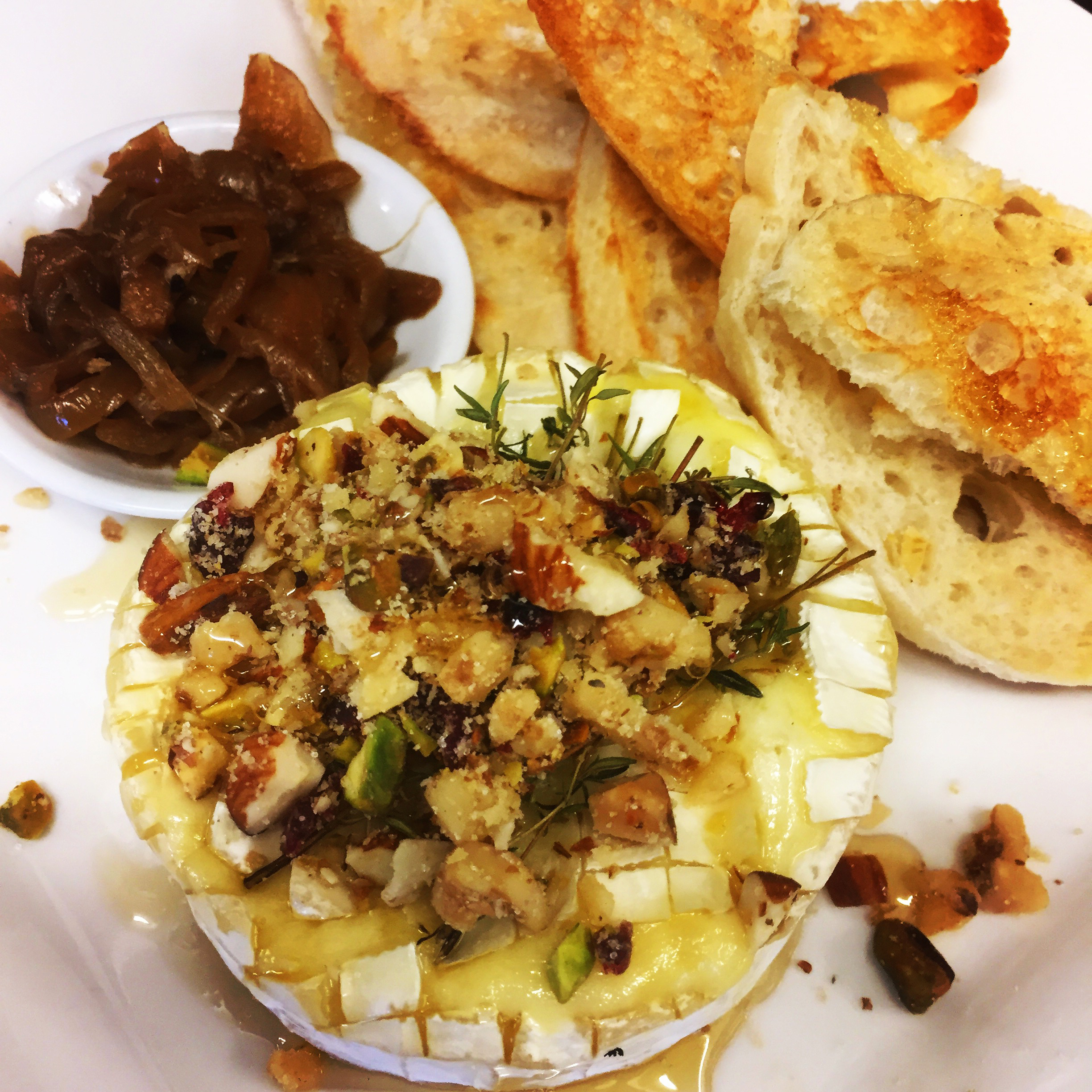 Baked Camembert - topped with a walnut, almond, cranberry, pistachio nut crumble, served with caramelised onion jam and toast