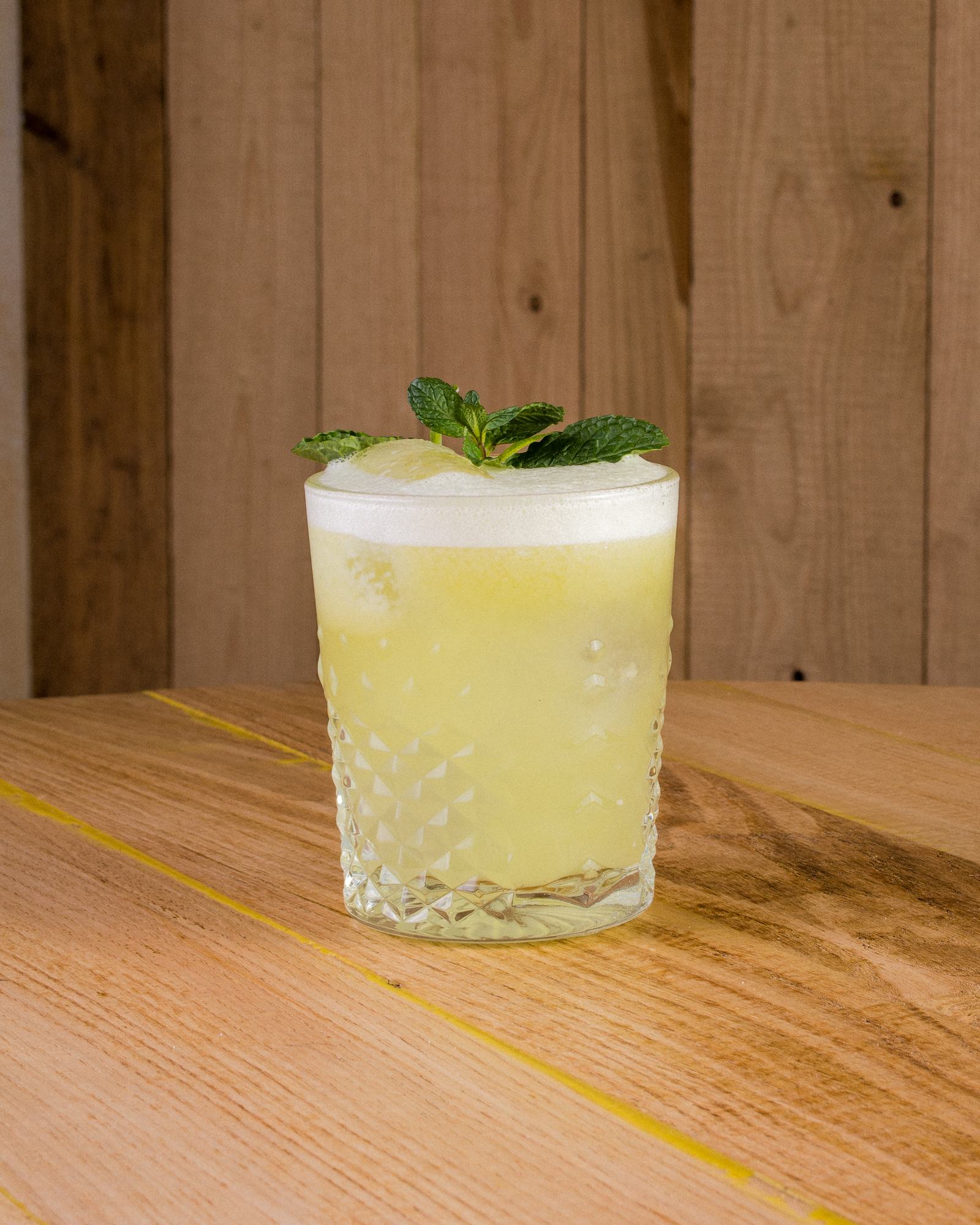 Verdoni   Green Soul, Mayan Spirit   Only natural ingredients: 50ml of VITA, 30ml of Mezcal (first Verdoni prepared with Mezcal Amores), 25ml of fresh lime juice, 20ml of Agave sirope, 25ml of organic apple purée, egg white (only organic eggs) and fresh mint.  The jungles of the Mexican SouthWest sing through your senses while enjoying this drink. Give in to your wildest instincts and dance through the night with smokey empowerment.