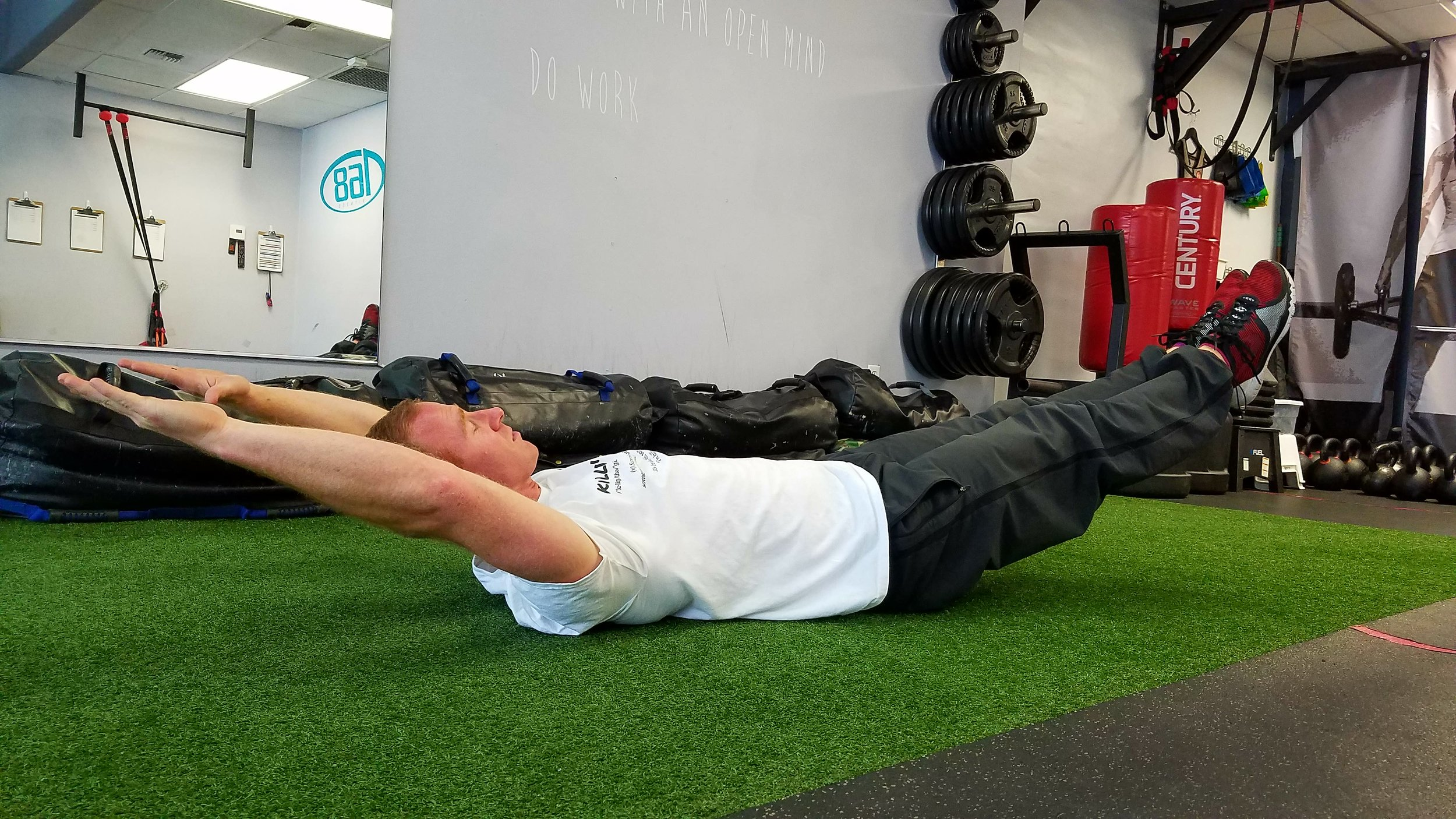 Press your lower back against the floor while lifting legs, shoulder blades and head off the ground.