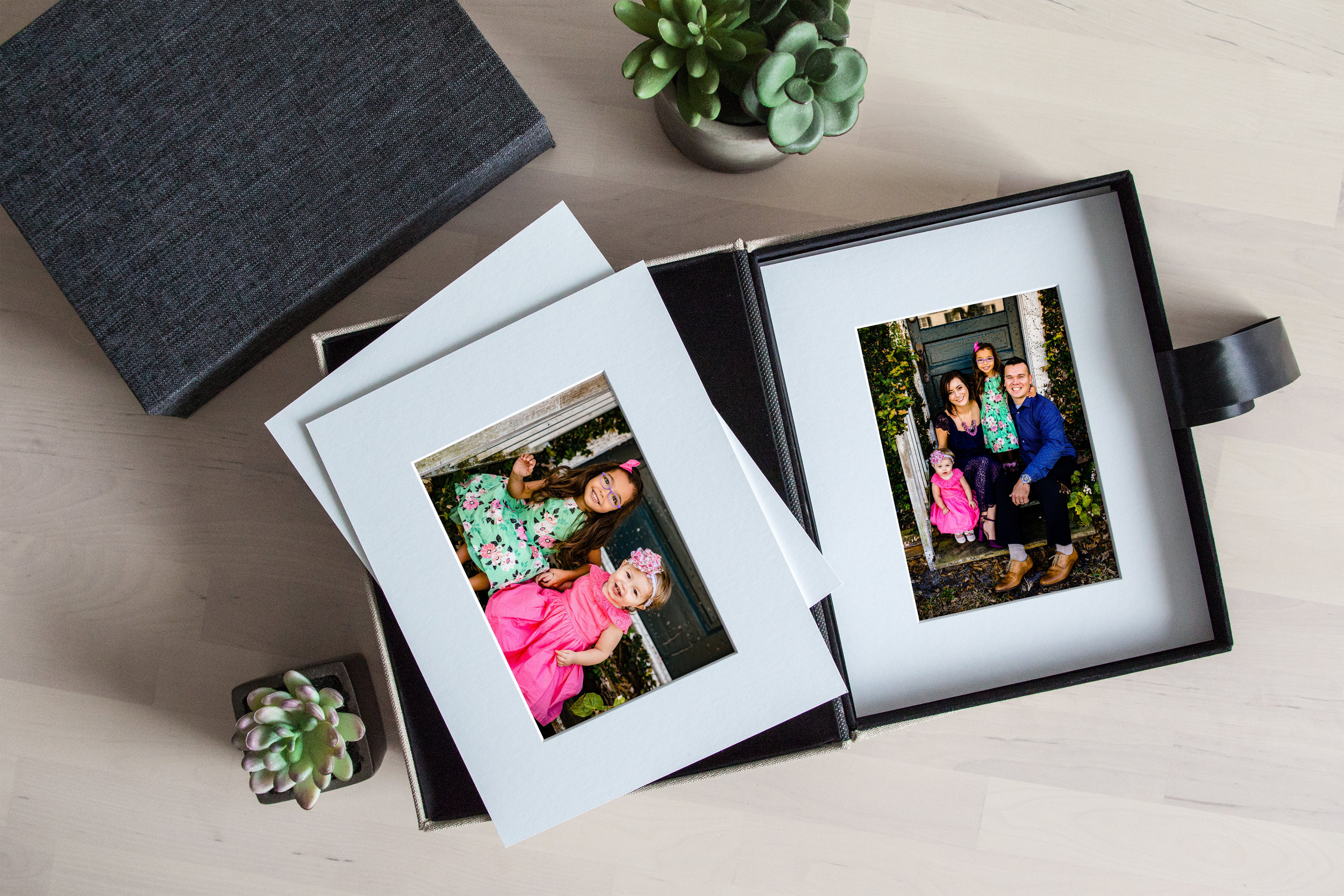Matted Folio Boxes - Our matted folio boxes are perfect for keeping a collection of your favorite memories readily available. Perfect to keep to thumb through, opt to put one or two on display, change them out and add to your collection!