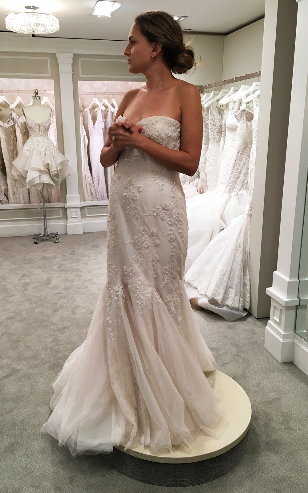 Discovering my  actual  wedding gown. It was the last one I tried on, as the store was closing for the night.
