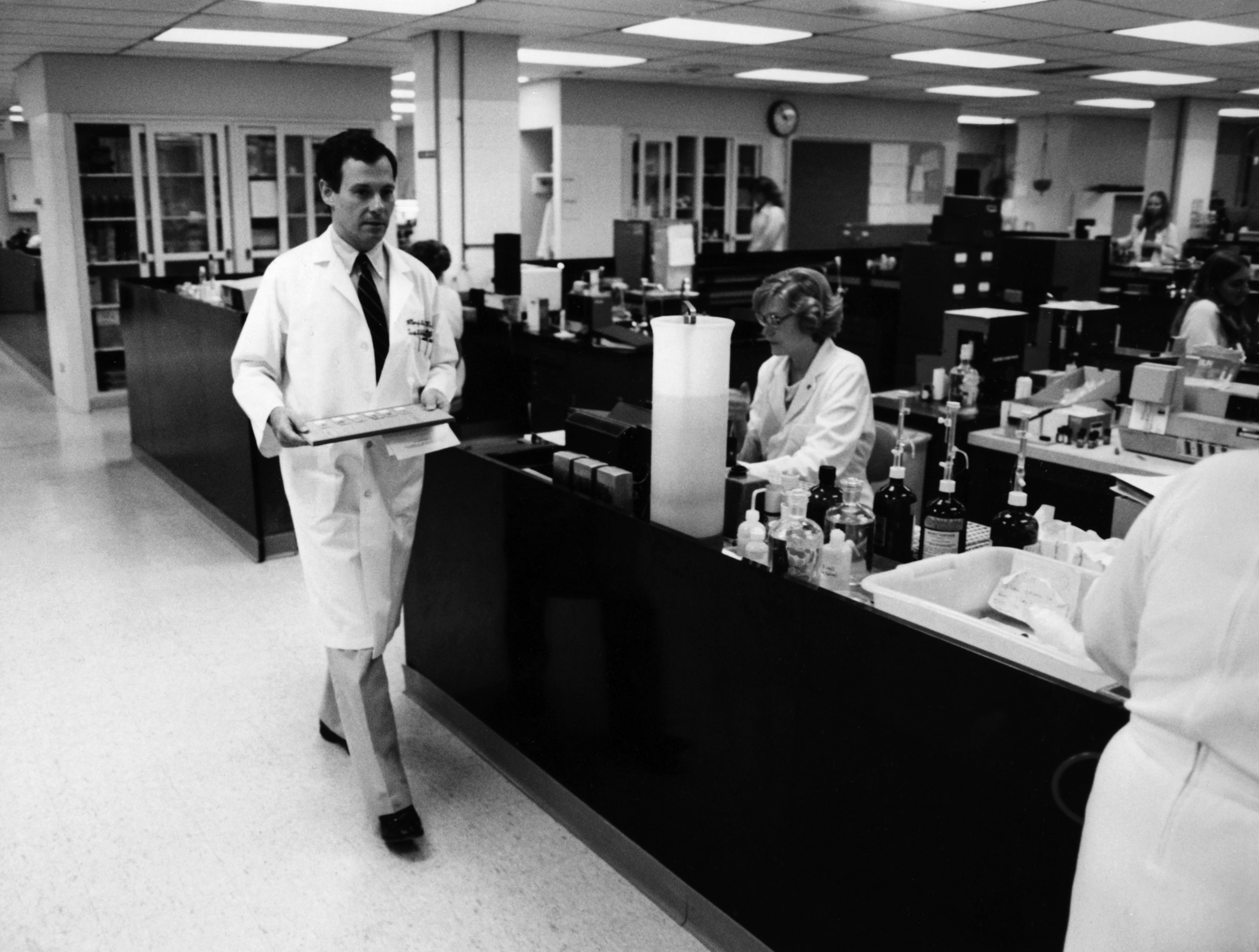 Dr. Milton Finegold in the pathology lab in the 1980s.
