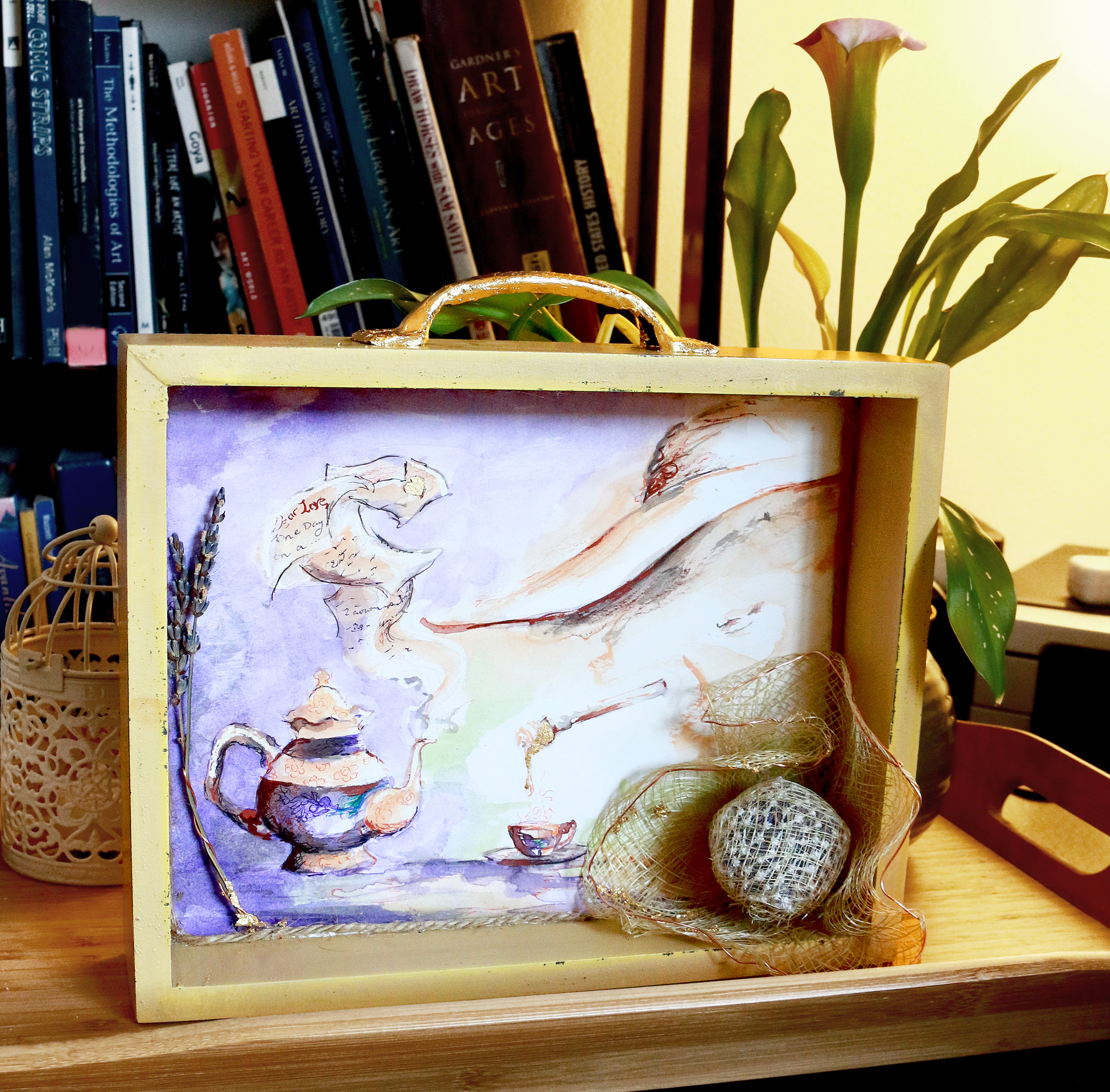 """This painting above is a multi-media water piece that I had so much fun making! I have two more similar ones on the way. This one is called """"Lavender Honey"""" and has real dried lavender inside the hat on the bottom right. It smells so good! The frame is a drawer and there is gold leaf painting in some areas to give the piece a twinkle of shine and warmth. Yey! Selling it at $200."""