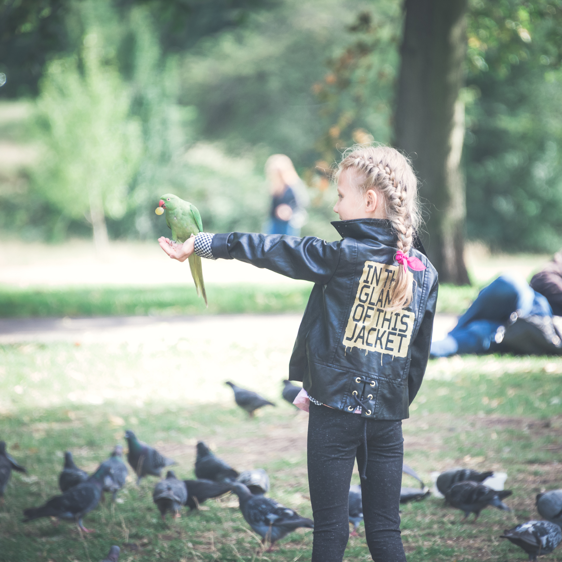 girl-with-parrot-park