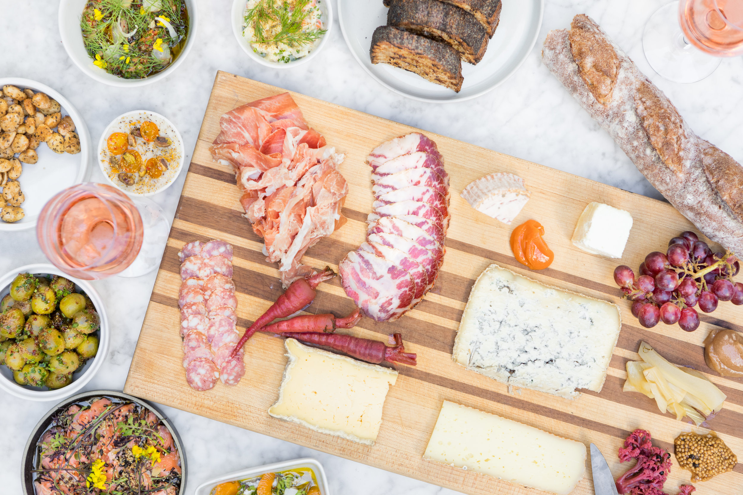Charcuterie tray with many meat, cheese, and spread selections