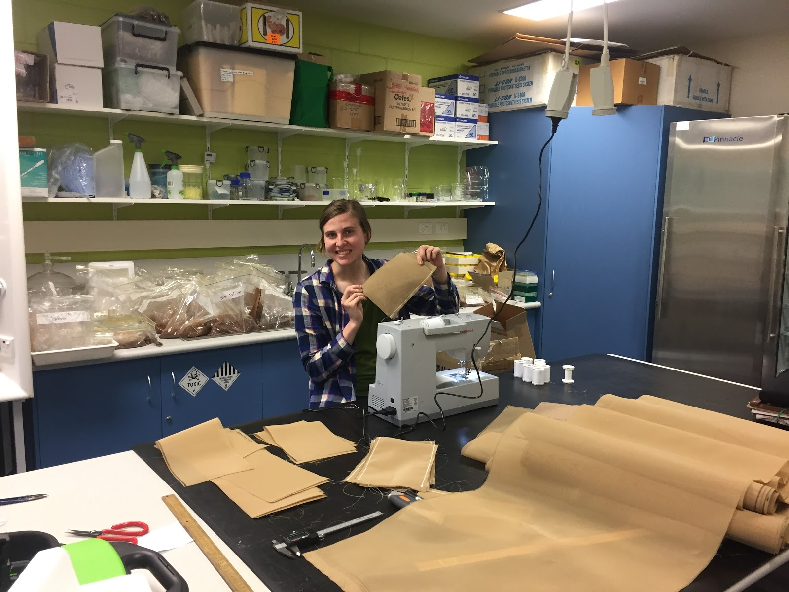 Rebecca Clement preparing bags that will hold samples of various Australian tree species. Decomposition rates and causes will be studied over time. Rebecca is the entomologist for this study. Her work for this project focuses on tree eating termites.