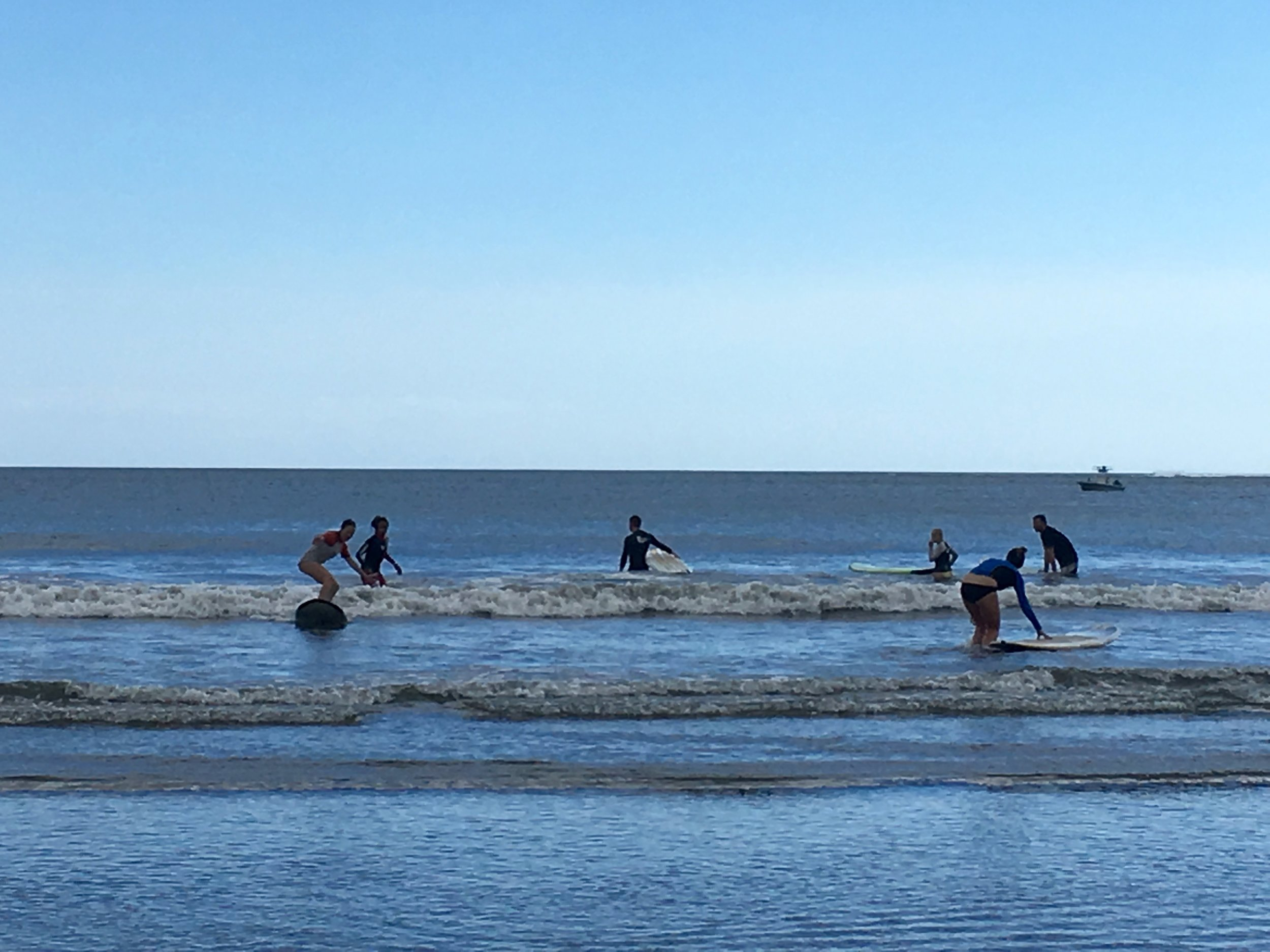 The crew out surfing Monday morning before the first day of work