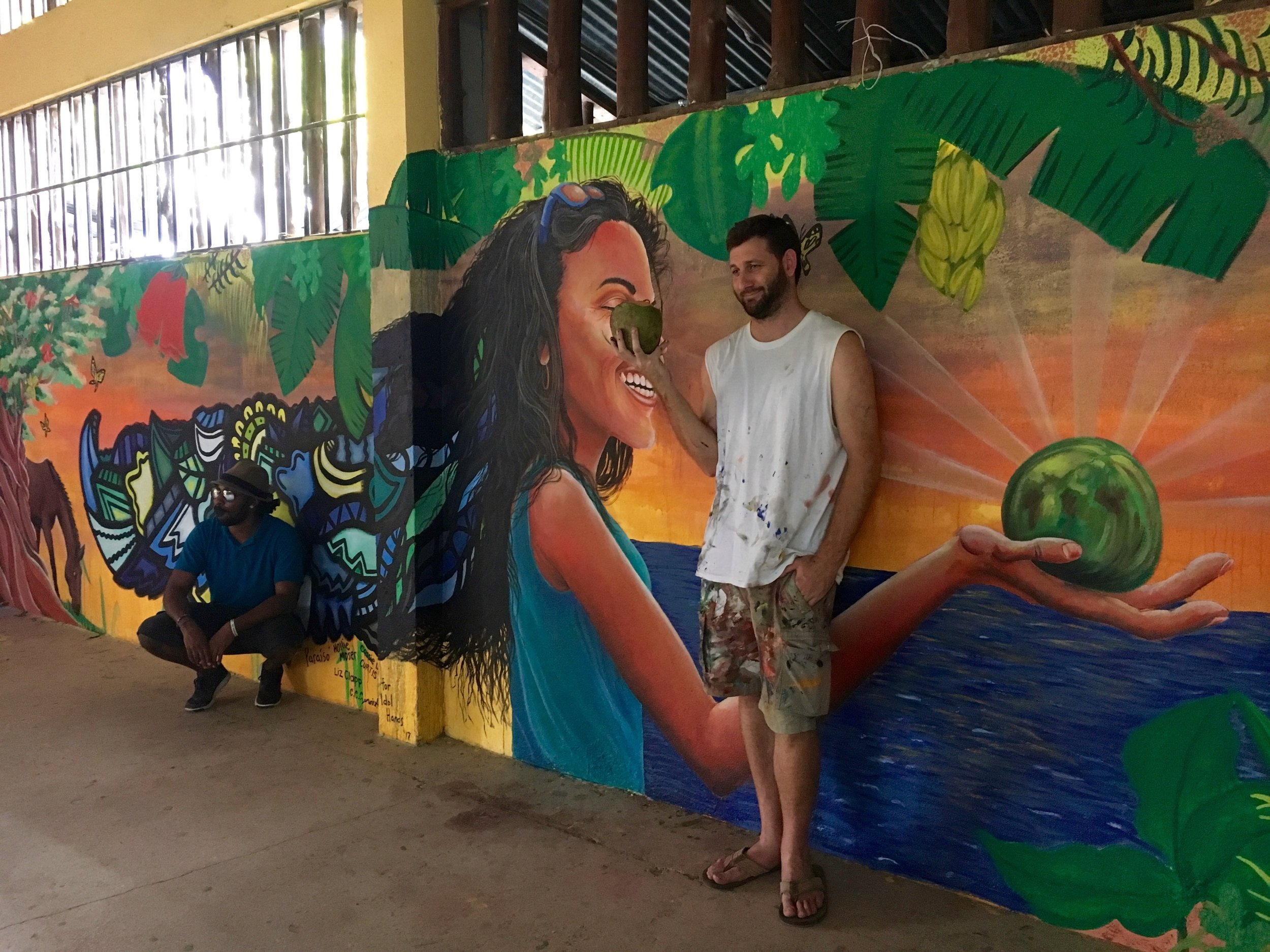 Alloyius McIlwaine (left) and Curtis Glover (right) posing in front of the finished mural
