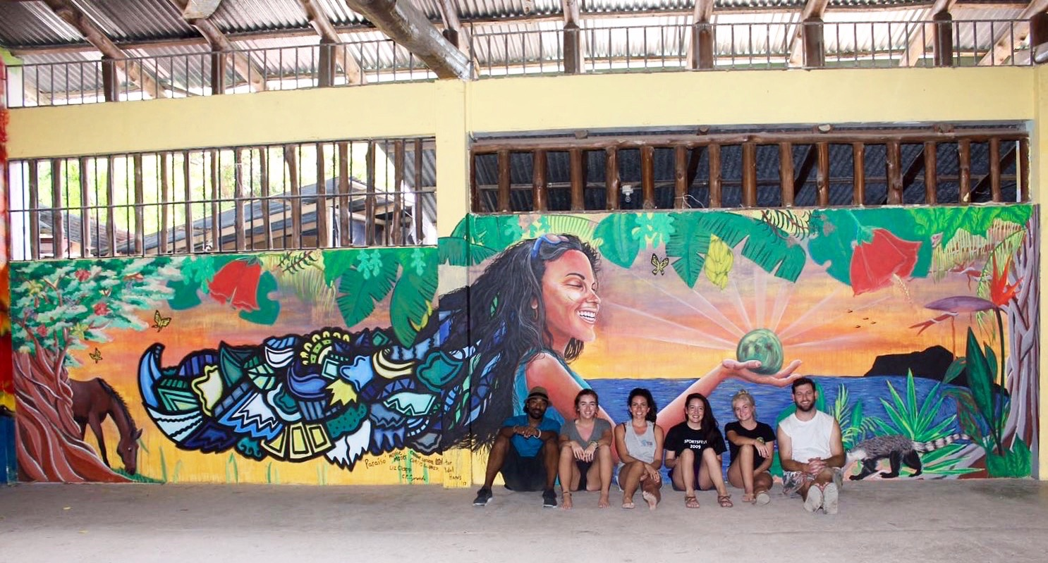 The crew in front of the final mural (Left to right: Alloyius McIlwaine, Hollie Moser, Catherine Czerwinski, Liz Clapp, Cassie Larson, Curtis Glover)