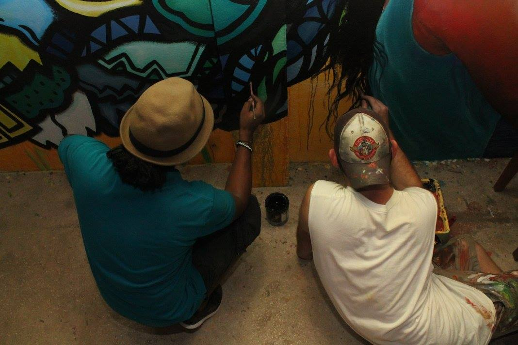 Artists Alloyius McIlwaine (left) and Curtis Glover (right) adding finishing touches