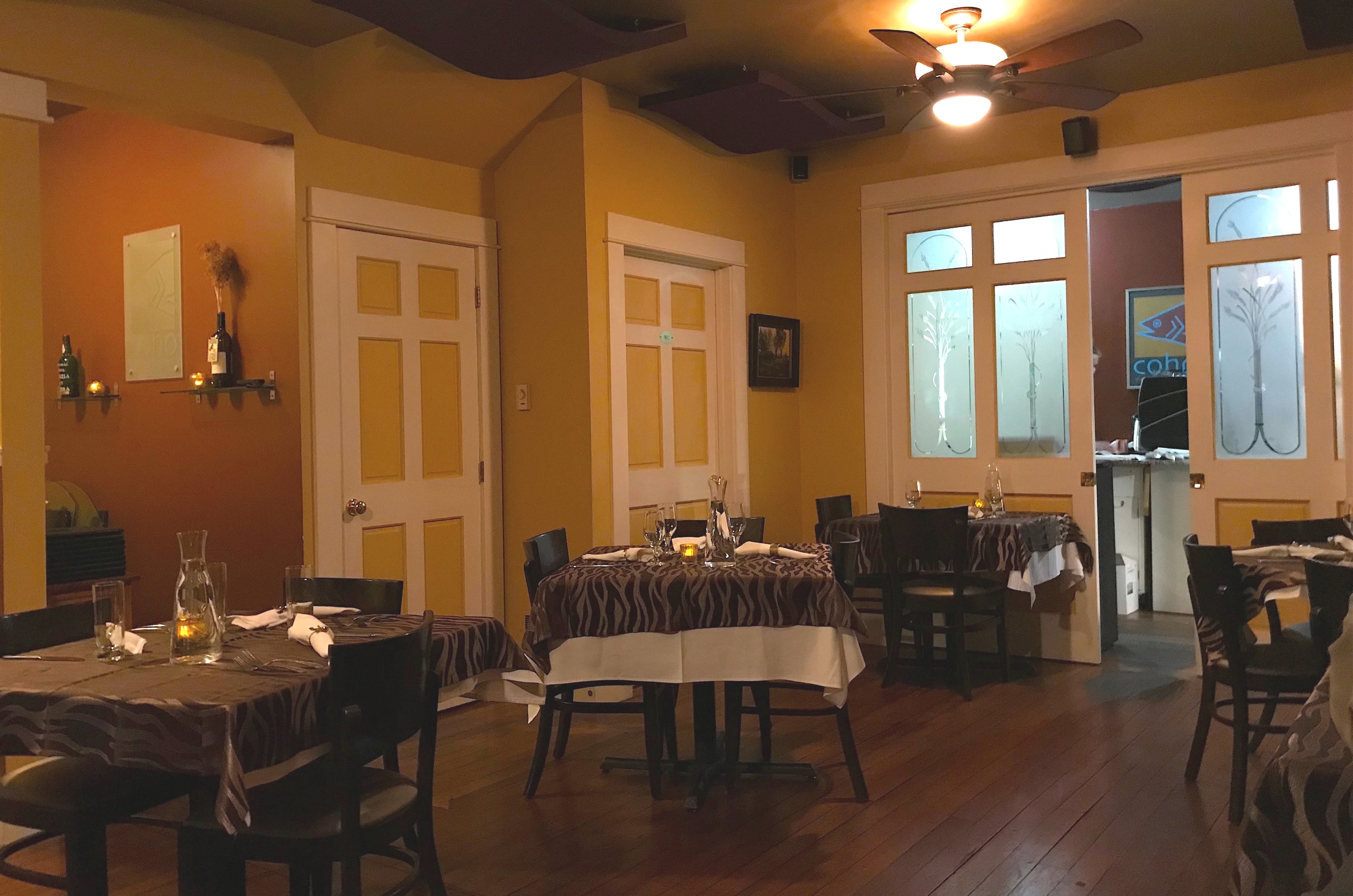COHO Restaurant's romantic dining room and kitchen entrance, where the magic happens
