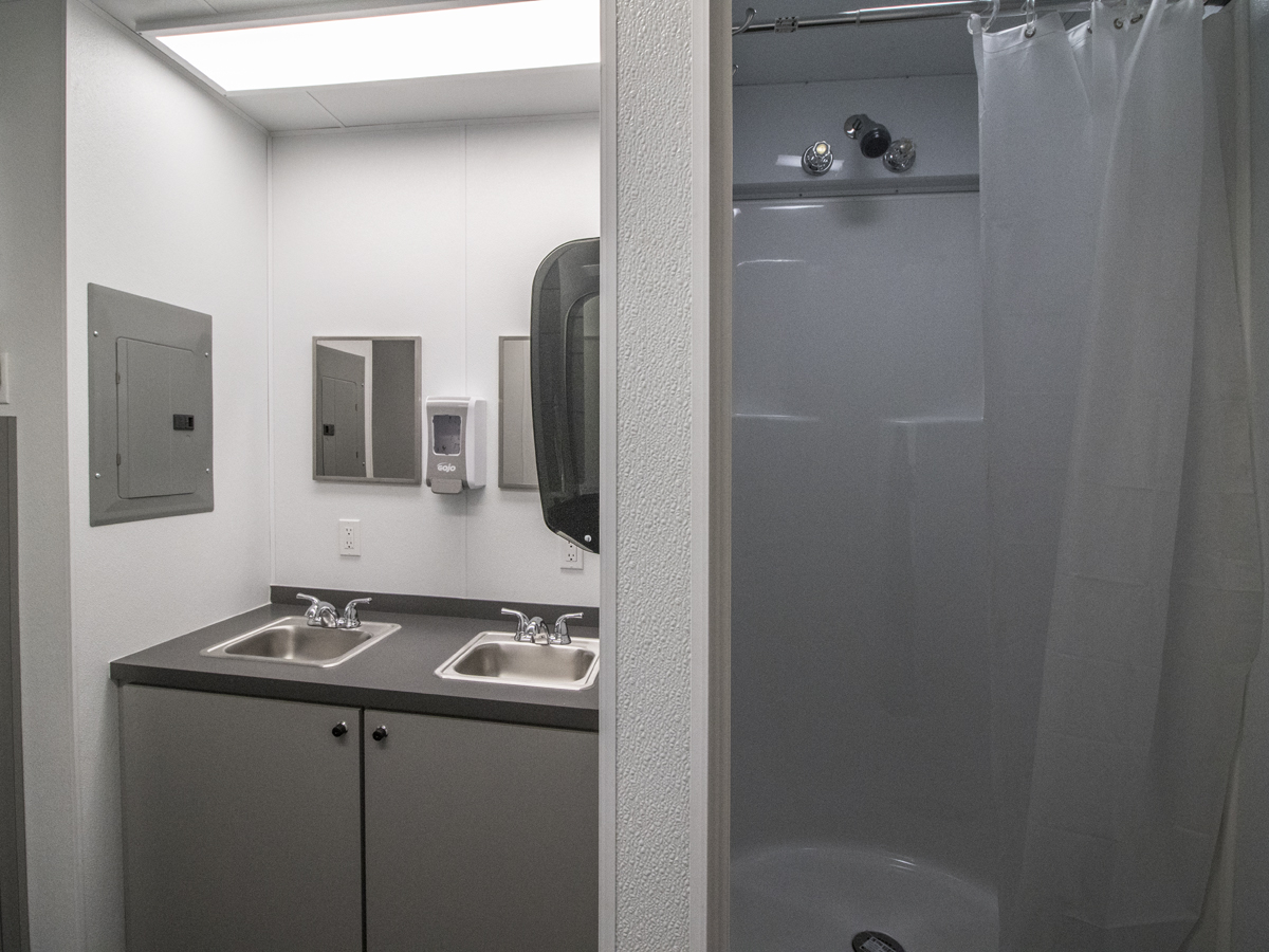 Containerized shower and sink unit